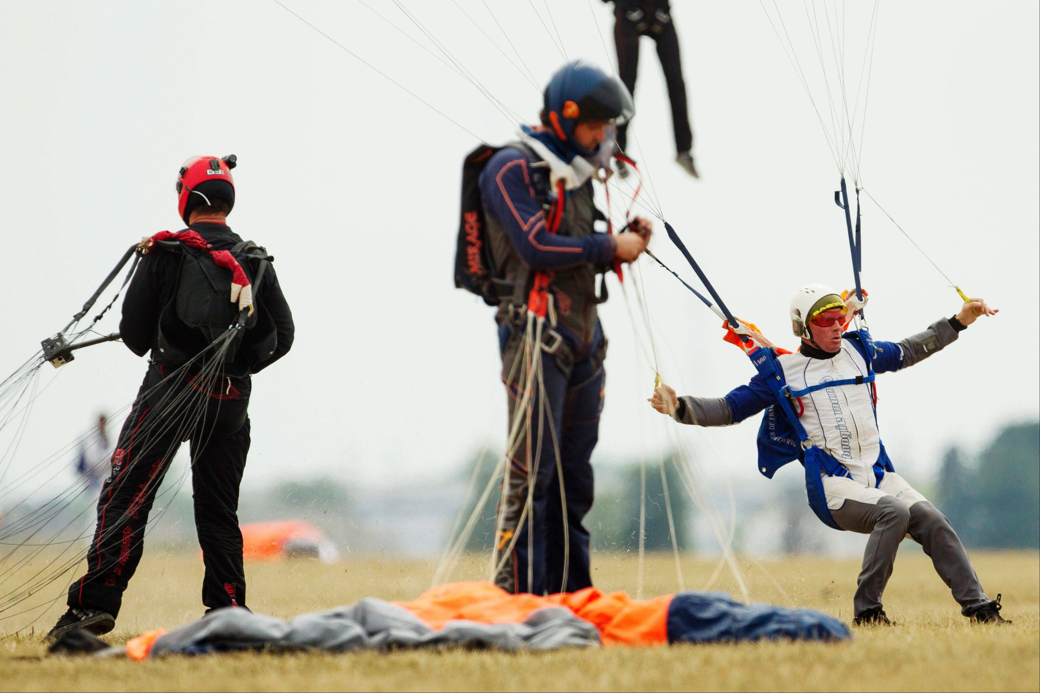 Skydivers land in a drop zone during practice Thursday in Ottawa, Ill. More than 140 sky divers reaching speeds in excess of 180 mph gathered in the skies over central Illinois to set a new world record in vertical flying.