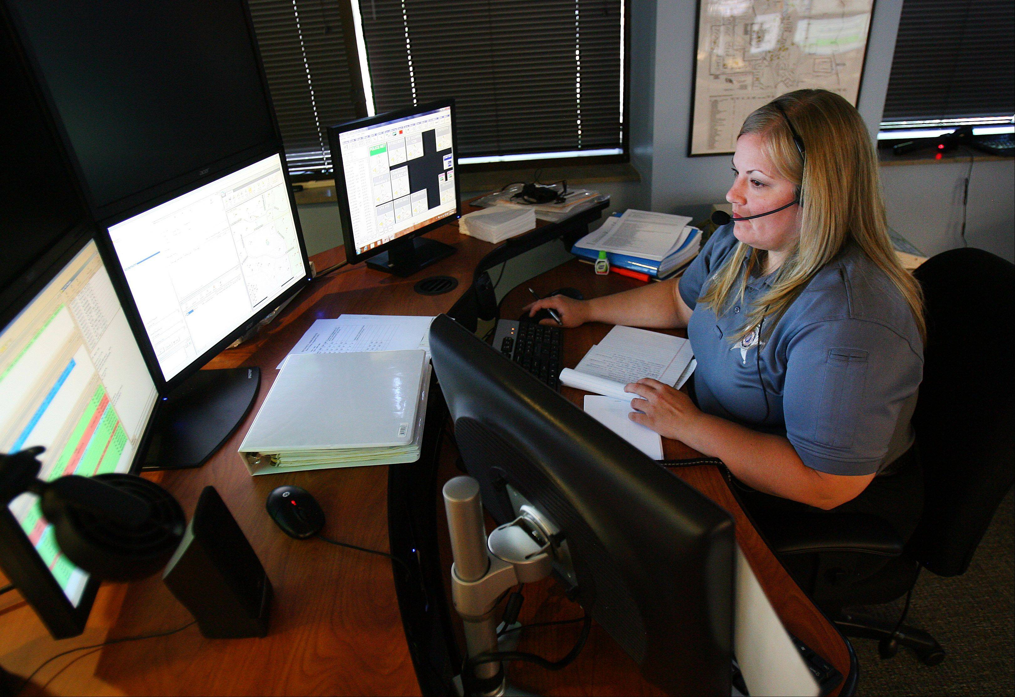 Vernon Hills Police dispatcher Sarah Silliman handles calls for the Libertyville Police Department. Vernon Hills began handling calls for Libertyville this week.