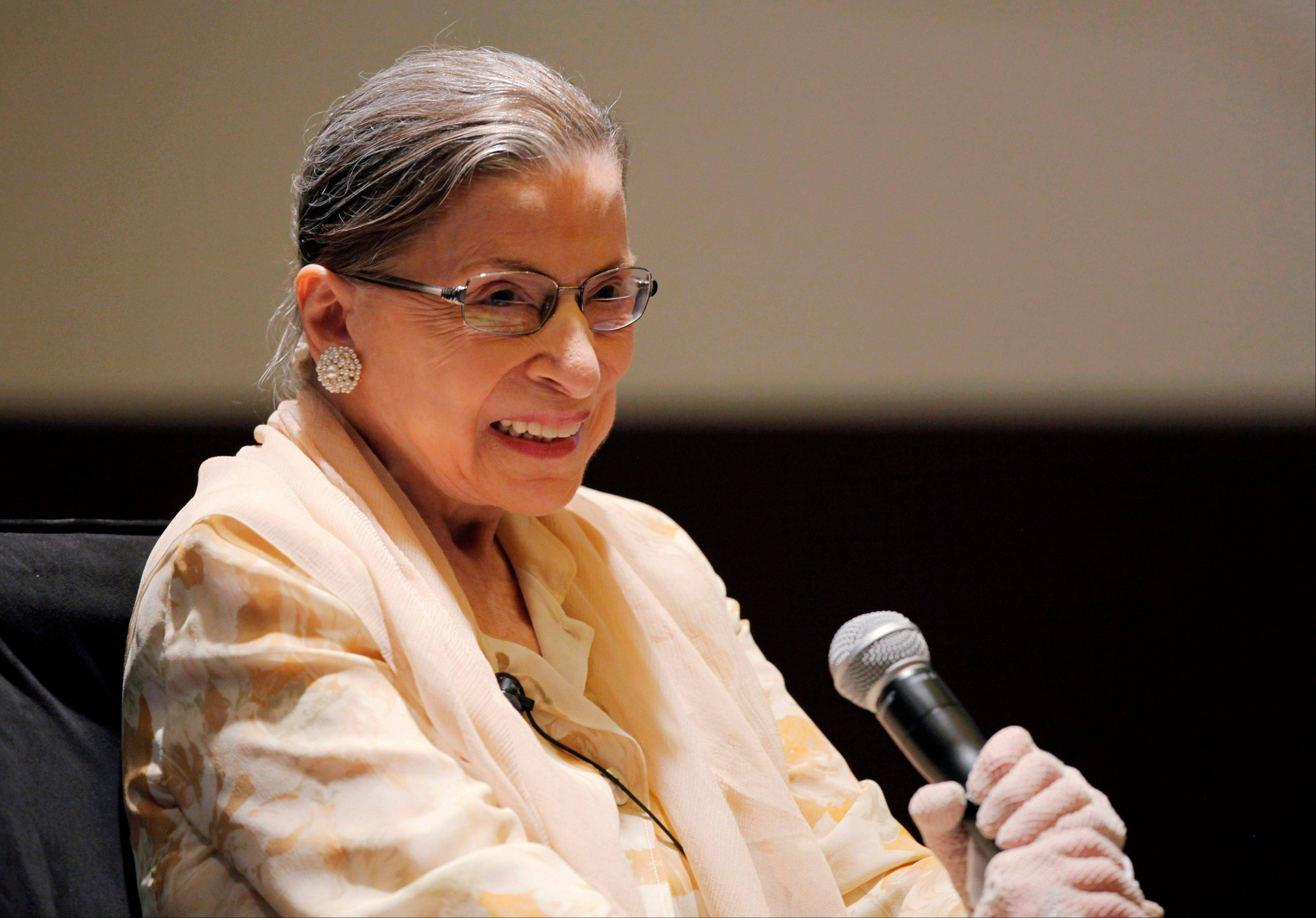 Supreme Court Justice and opera aficionado Ruth Bader Ginsburg participates in a panel discussion Friday during the American Bar Association's annual meeting in Chicago. Ginsburg was joined other panelists as they listened to performances of arias in an unusual discussion of the lessons operatic performance can bring to the law.