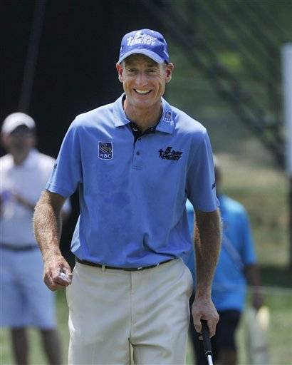 Jim Furyk is all smiles after shooting a second round four under 66 at the Bridgestone Invitational golf tournament at Firestone Country Club, Friday in Akron, Ohio.