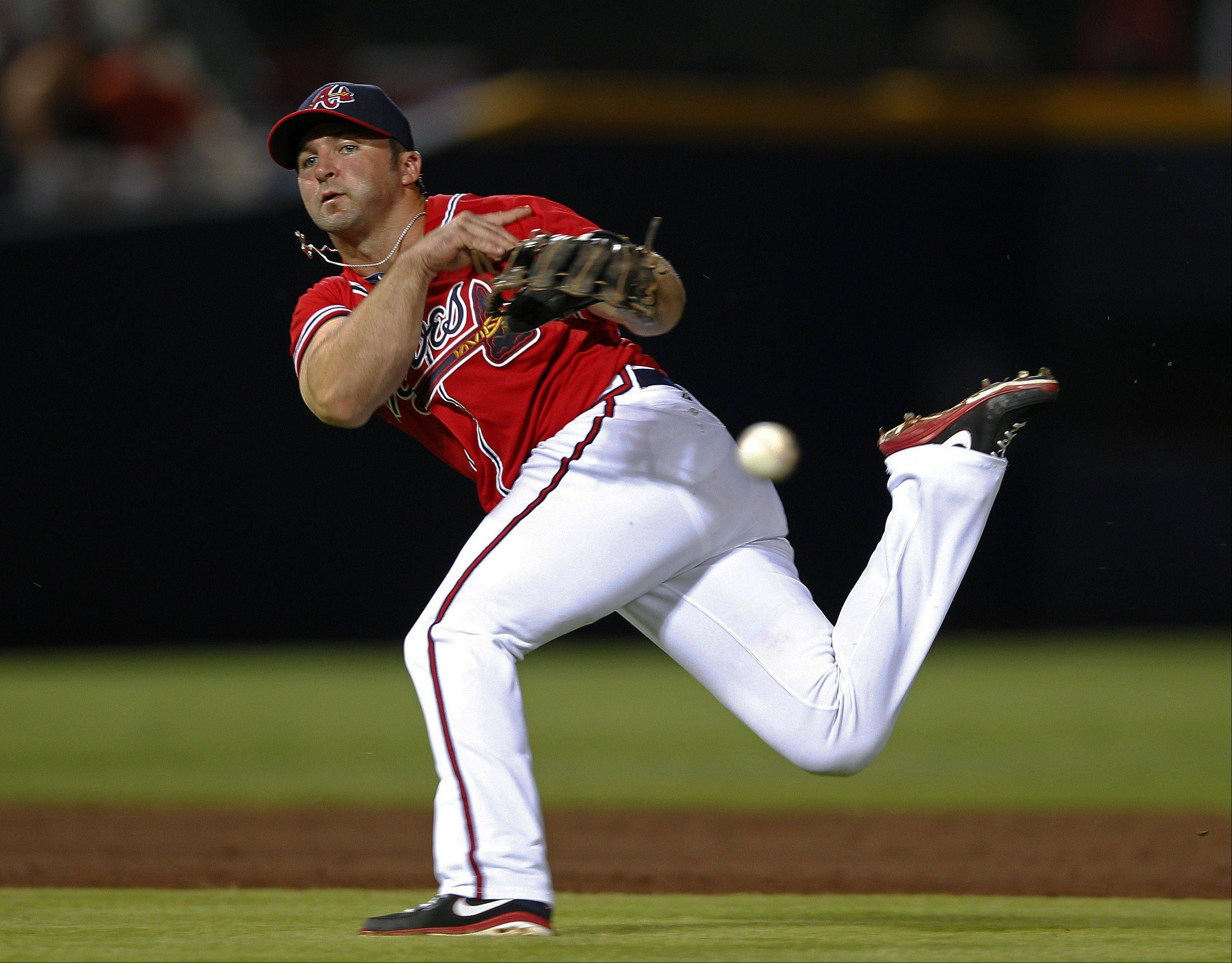 Braves second baseman Dan Uggla throws across his body after fielding a ball hit for a single by Houston's Ben Francisco in the sixth inning Friday at home.