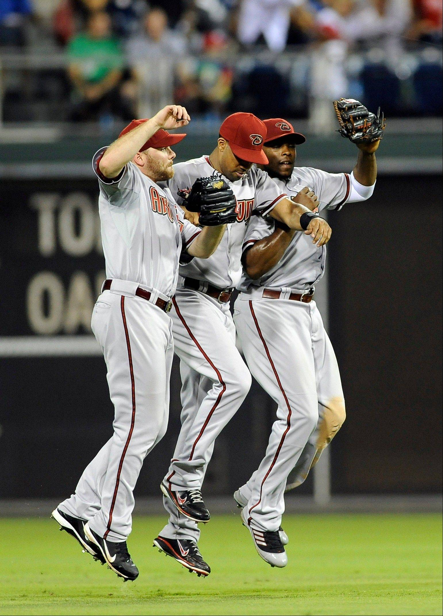 Associated Press The Diamondbacks' Jason Kubel, left, Chris Young, middle, and Justin Upton celebrate Friday's road win over Philadelphia.