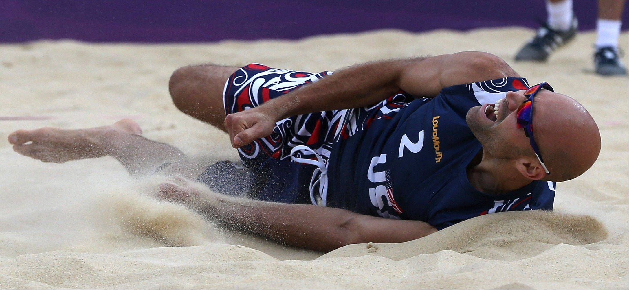 Phil Dalhausser dives into Friday sand during a Beach Volleyball match Against Italy at the 2012 Summer Olympics.