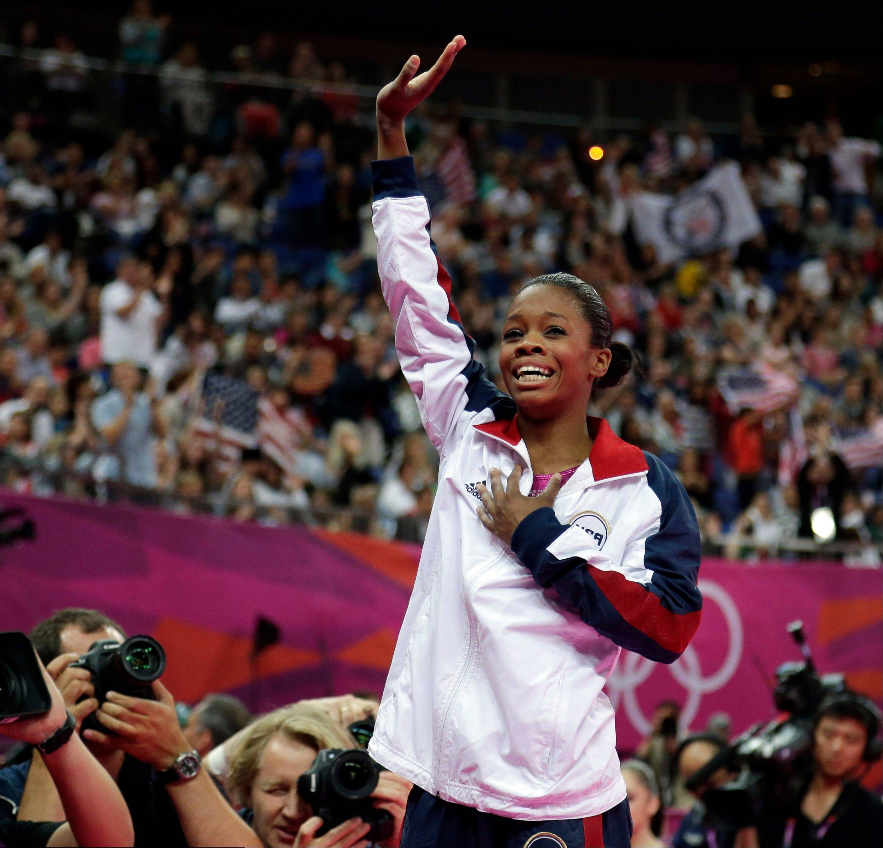 U.S. gymnast Gabrielle Douglas acknowledges the audience after being declared winner of the gold medal during the artistic gymnastics women's individual all-around competition at the 2012 Summer Olympics, Thursday, Aug. 2, 2012, in London.