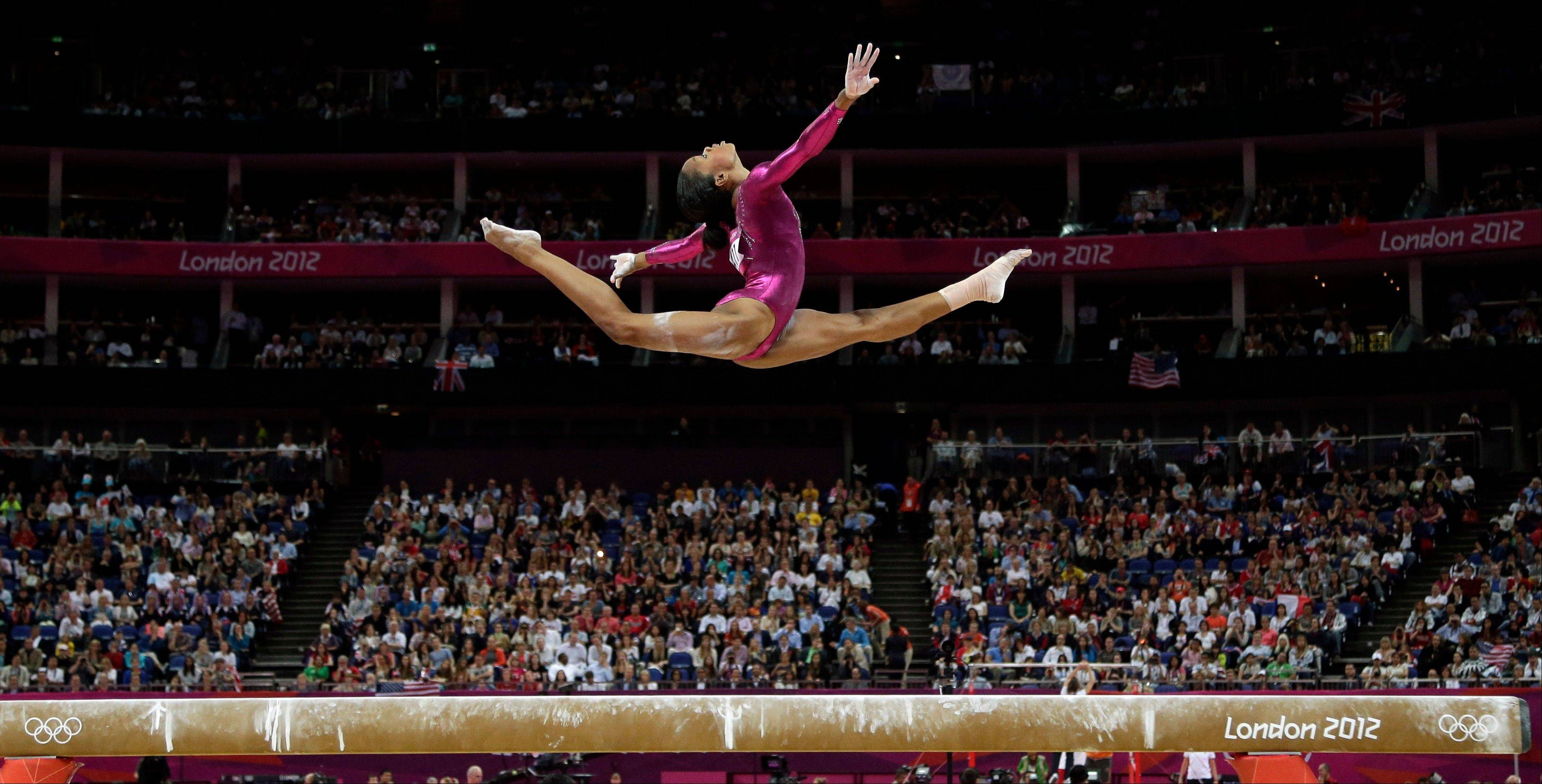 AP photographer Gregory Bull knew it would come — the moment when Gabby Douglas does that little bit extra. Her leap, high above the beam, in the women's all-around individual gymnastics competition on Thursday is one of the iconic shots of the London Games.