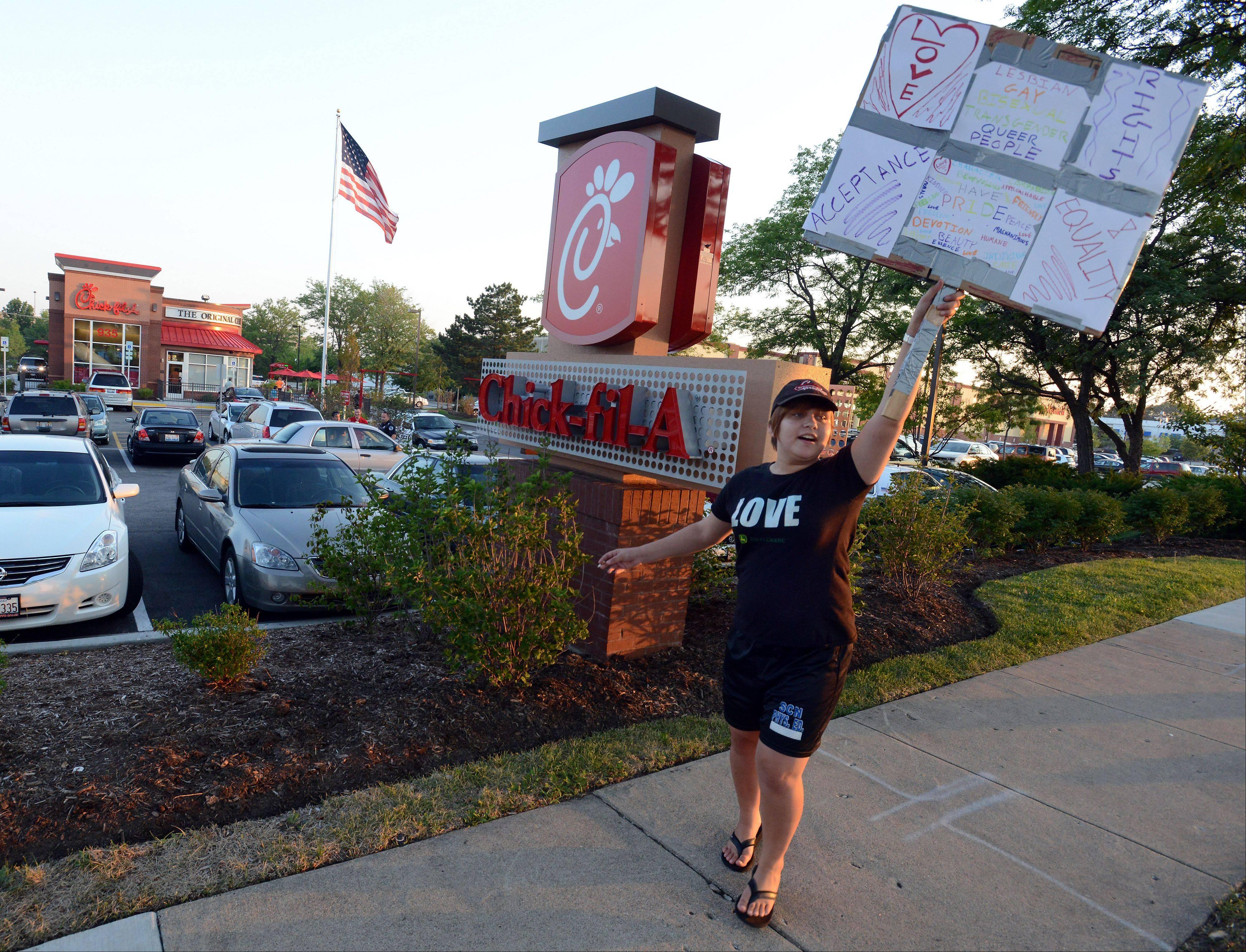 Liz Sibrava, 17, of St. Charles and two of her friends came to protest the Chick-fil-A president's stance against gay marriage at the Schaumburg restaurant on Friday.