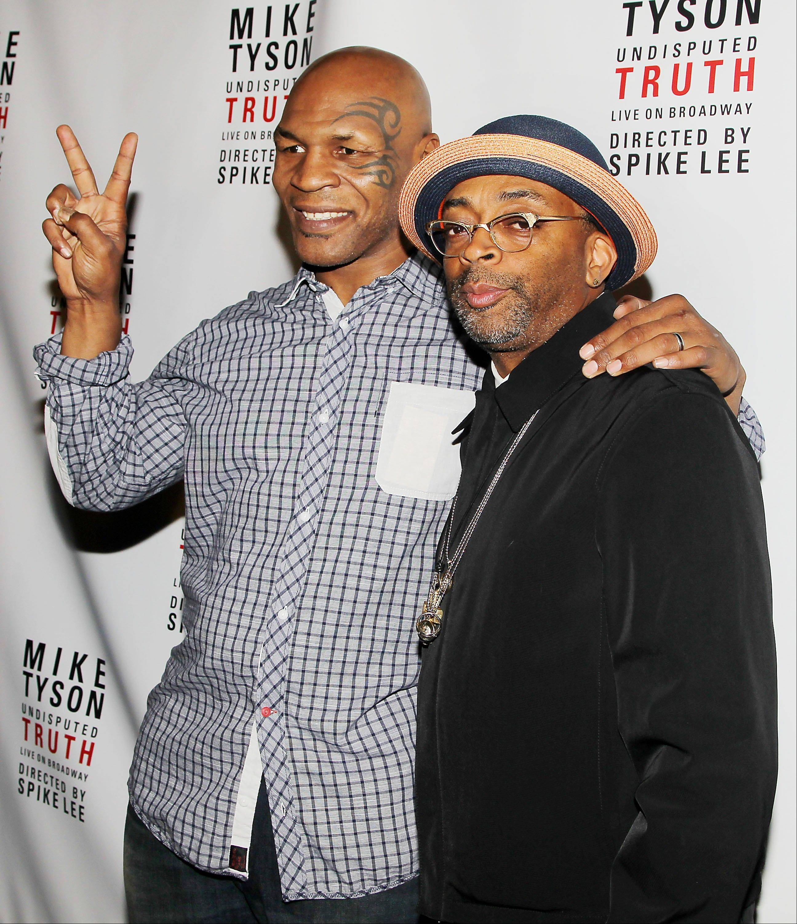 "Mike Tyson, left, and Spike Lee pose backstage after the curtain call on the opening night of ""Mike Tyson: Undisputed Truth,"" Thursday in New York. Lee directed the one-man show starring Tyson."