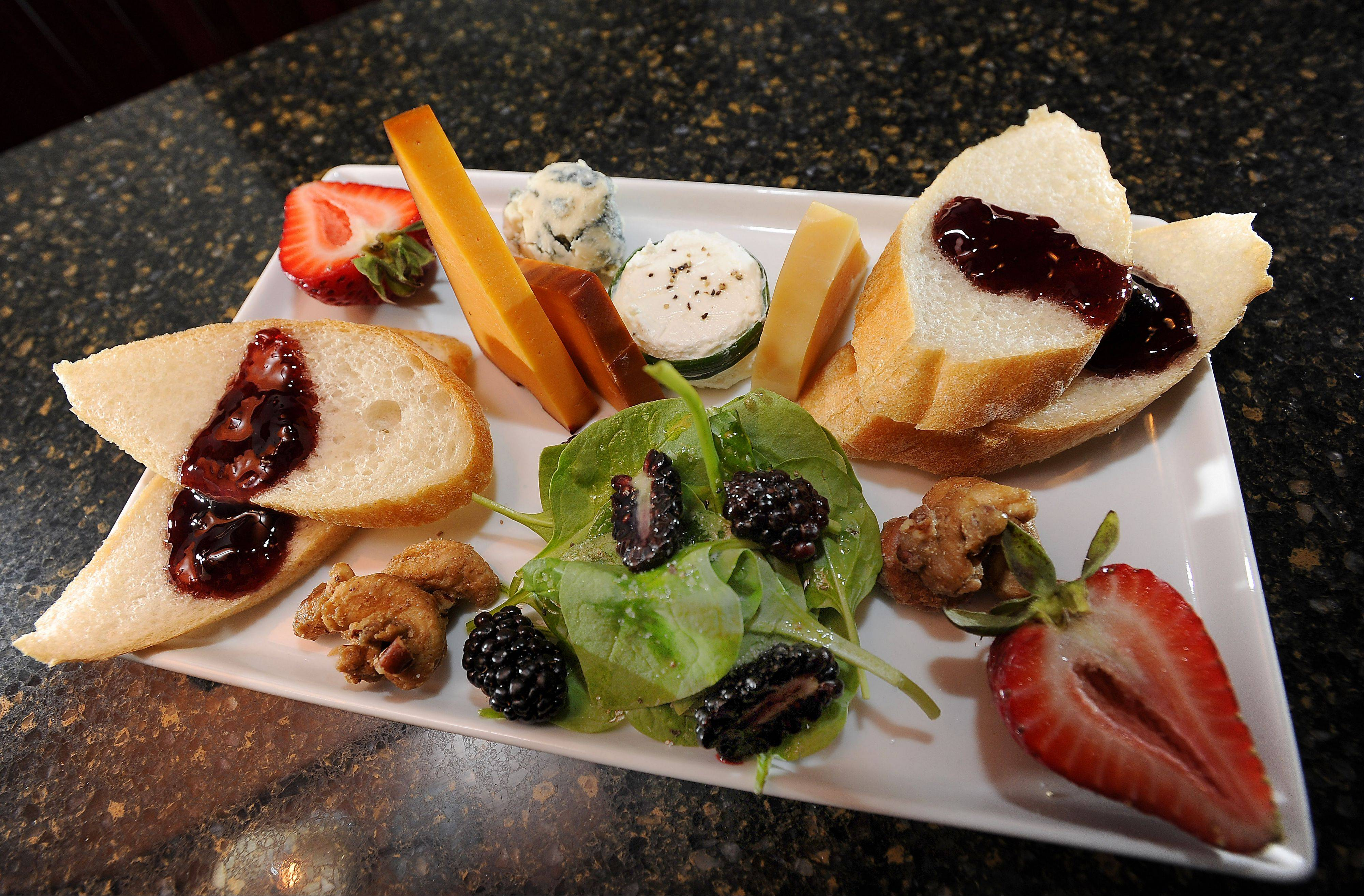 A selection of cheese is one of the items on the small plates menu at Smith Street Station in Palatine.