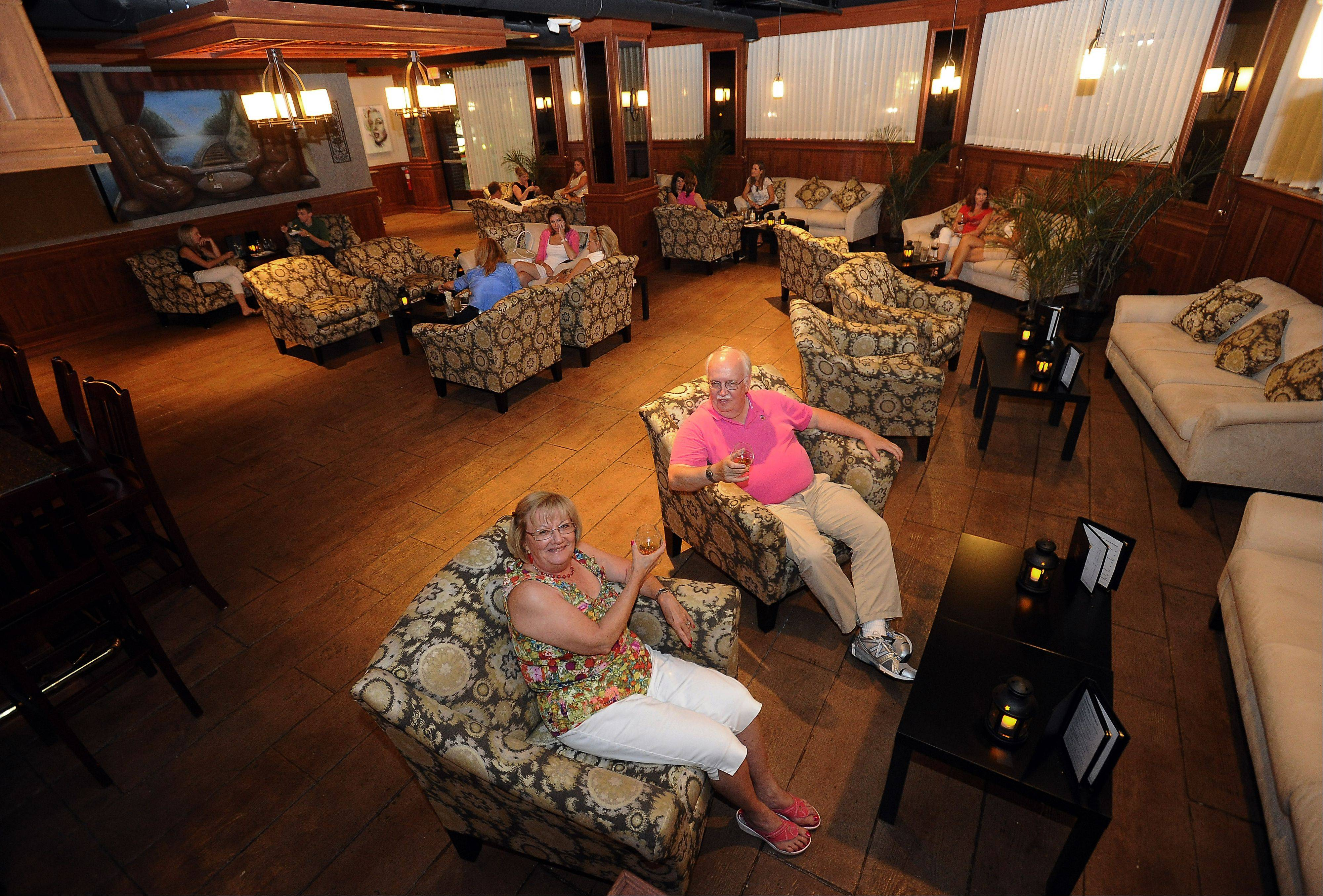 Wayne and Karin Karge, of Palatine, enjoy a drink in the conversation-friendly lounge at Smith Street Station in Palatine.