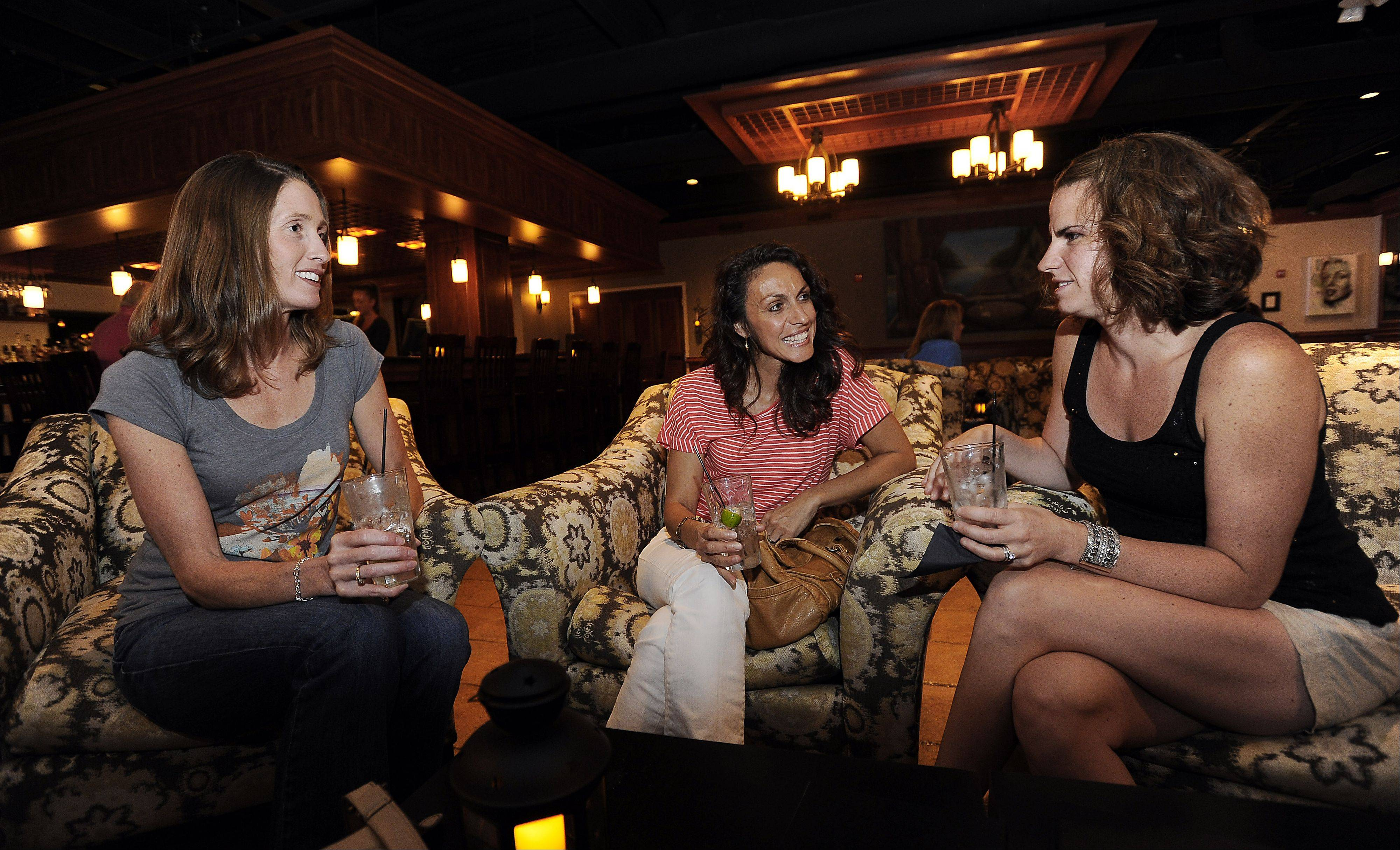 Alissa Kaspan, of Crystal Lake, enjoys drinks with Tisha Kaspari and Erin Kemp, both of Cary, at Smith Street Station in Palatine.