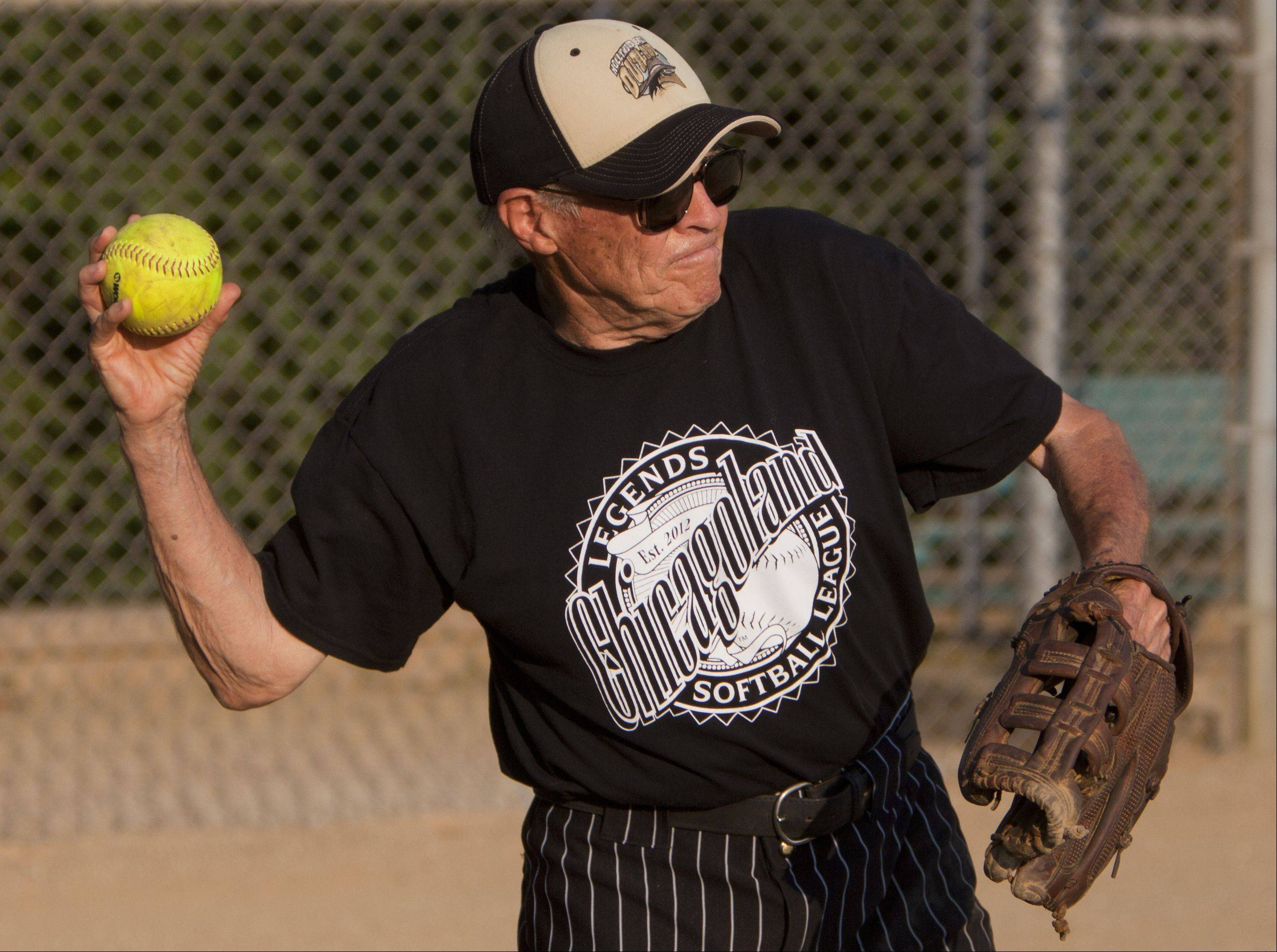 Ken Black, 82, the oldest member of the Chicagoland Legends Softball League throws the ball back to the pitcher.