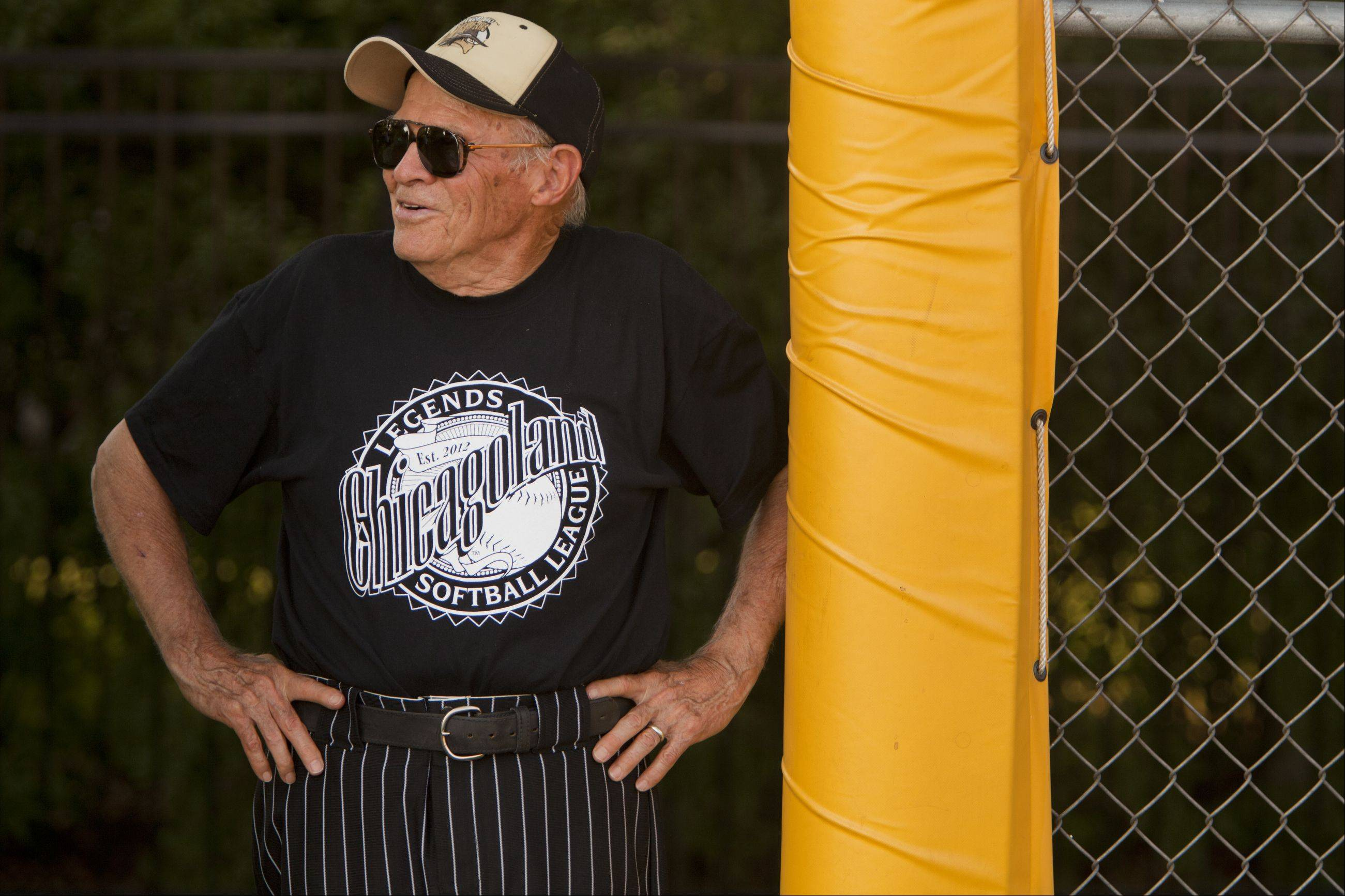 Ken Black, 82, the oldest member of the Chicagoland Legends Softball League stands along the fence before his first playoff game of the 2012 season.