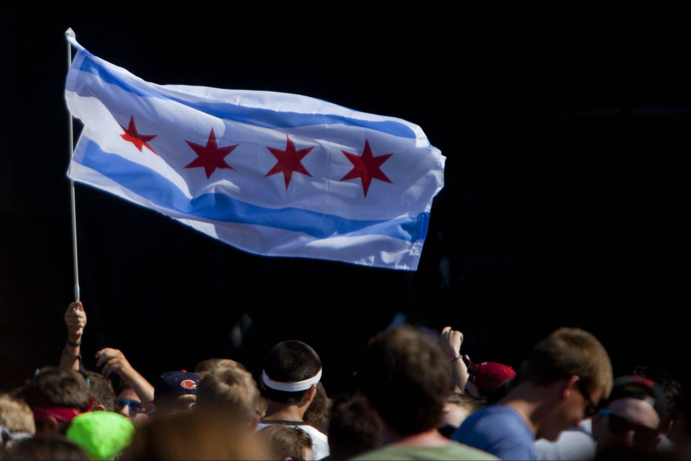 A fan waves a City of Chicago flag.