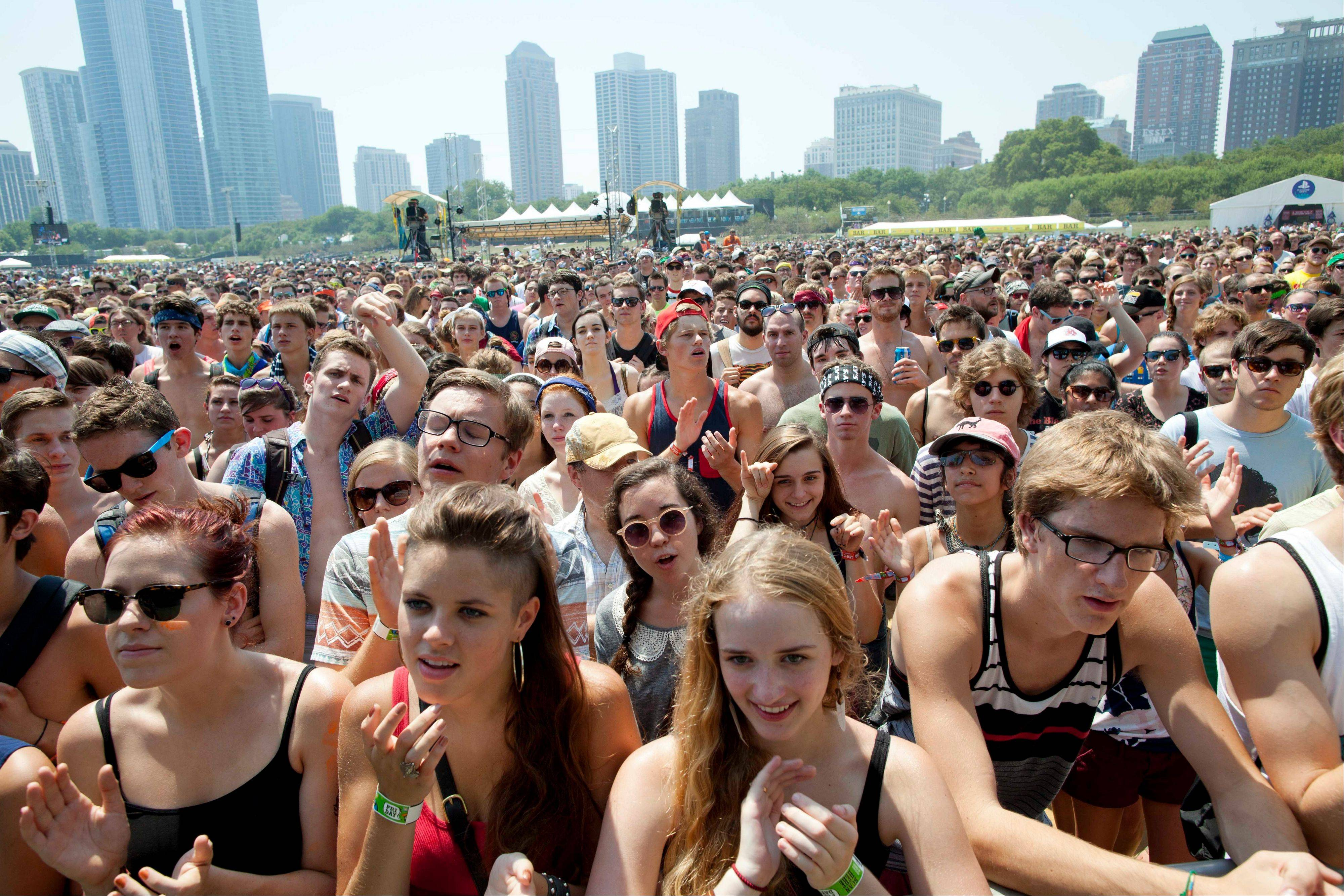 Fans gather for a performance by Yellow Ostrich XX at Lollapalooza in Chicago's Grant Park on Friday, Aug. 3, 2012.