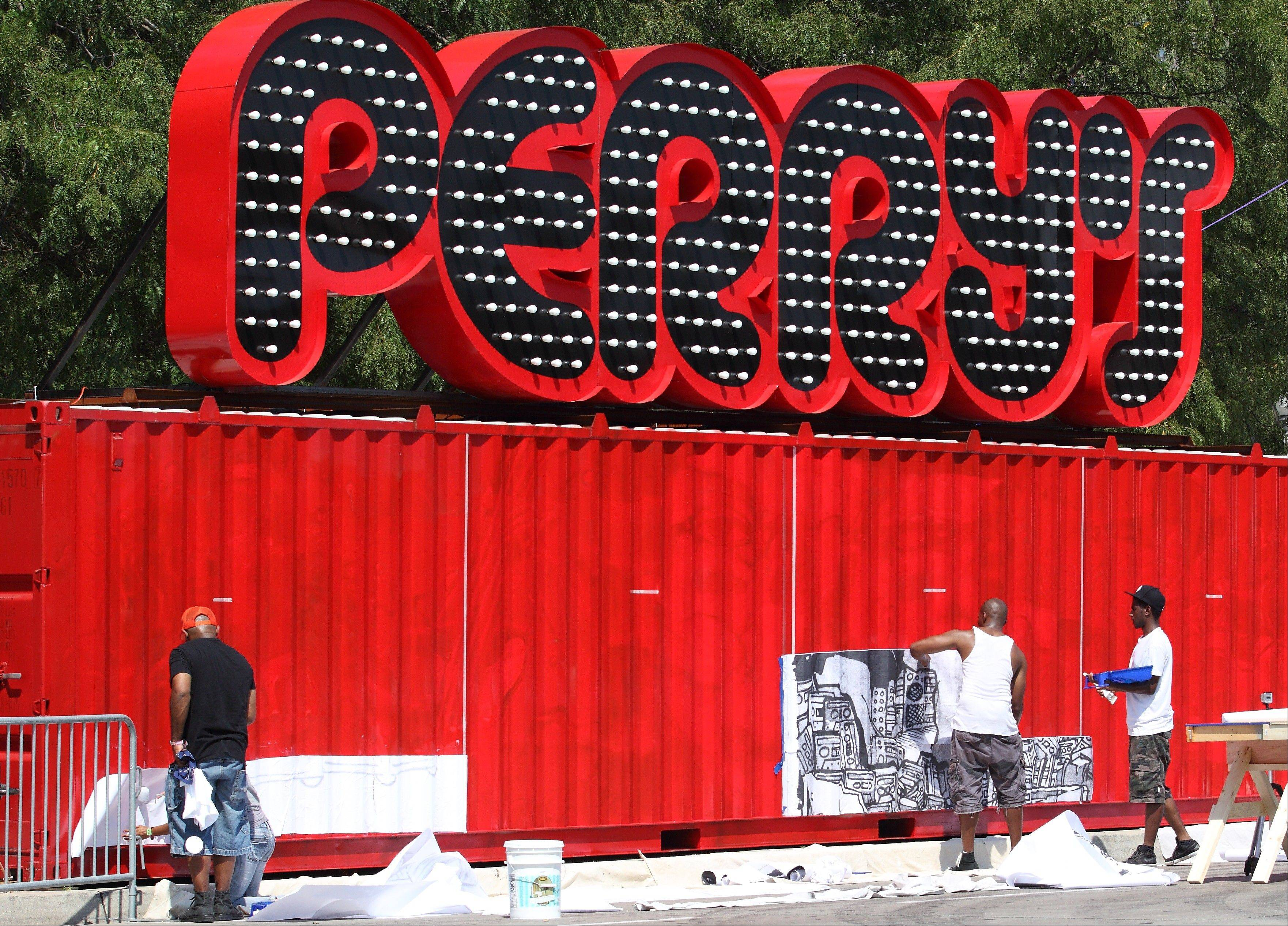 rtists put the finishing touches on the Perry's Stage sign at Lollapalooza in Chicago's Grant Park on Friday, Aug. 3, 2012.