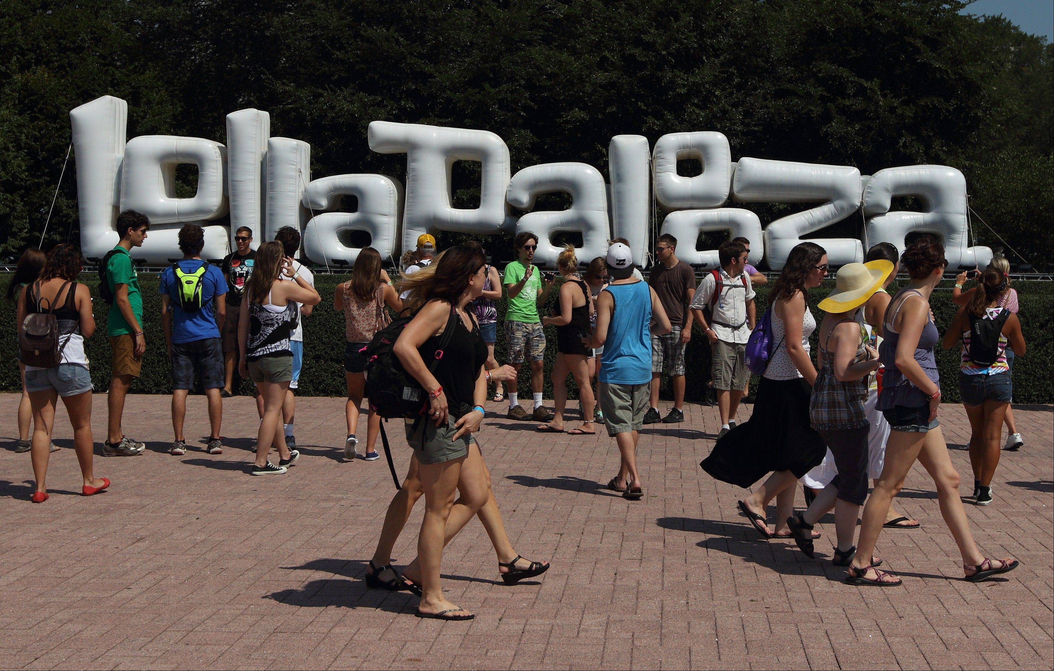 Music fans enter the Lollapalooza music festival in Chicago's Grant Park on Friday, Aug. 3, 2012.