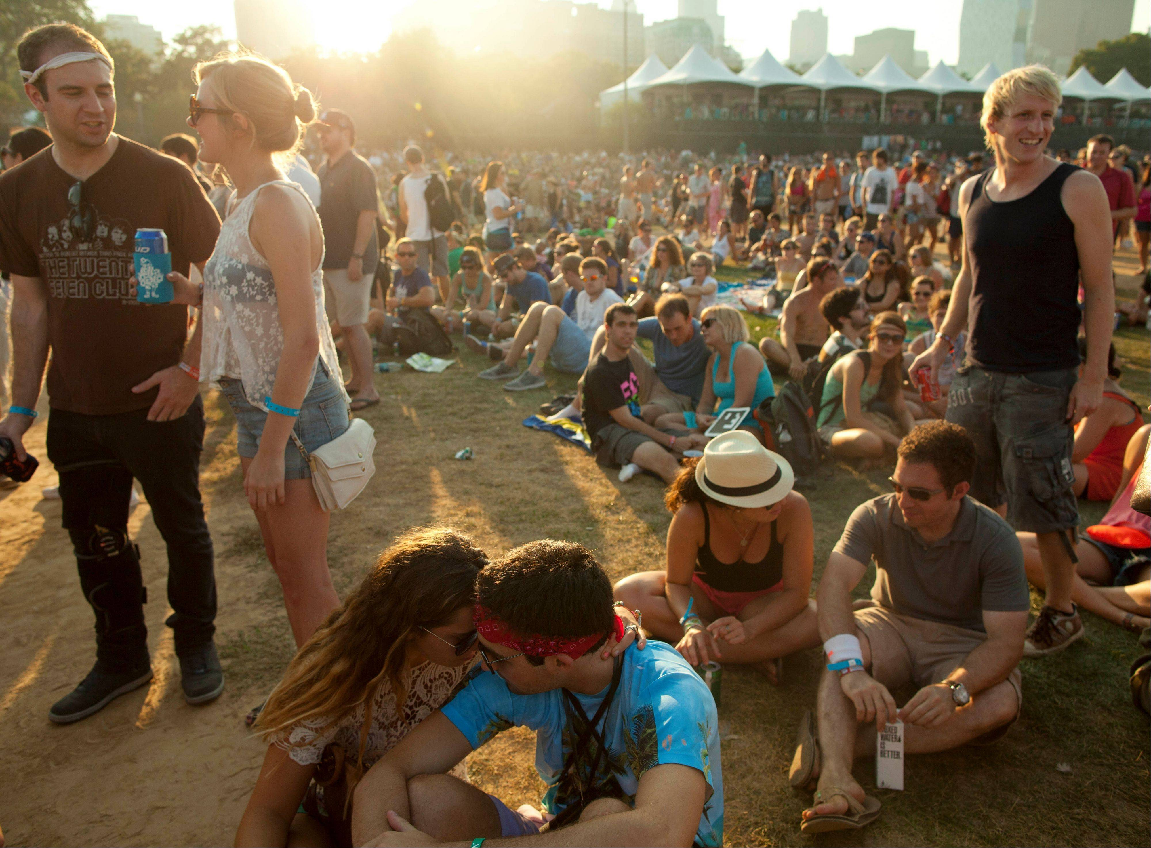 A couple shares a private moment at Lollapalooza in Chicago's Grant Park on Friday, Aug. 3, 2012.