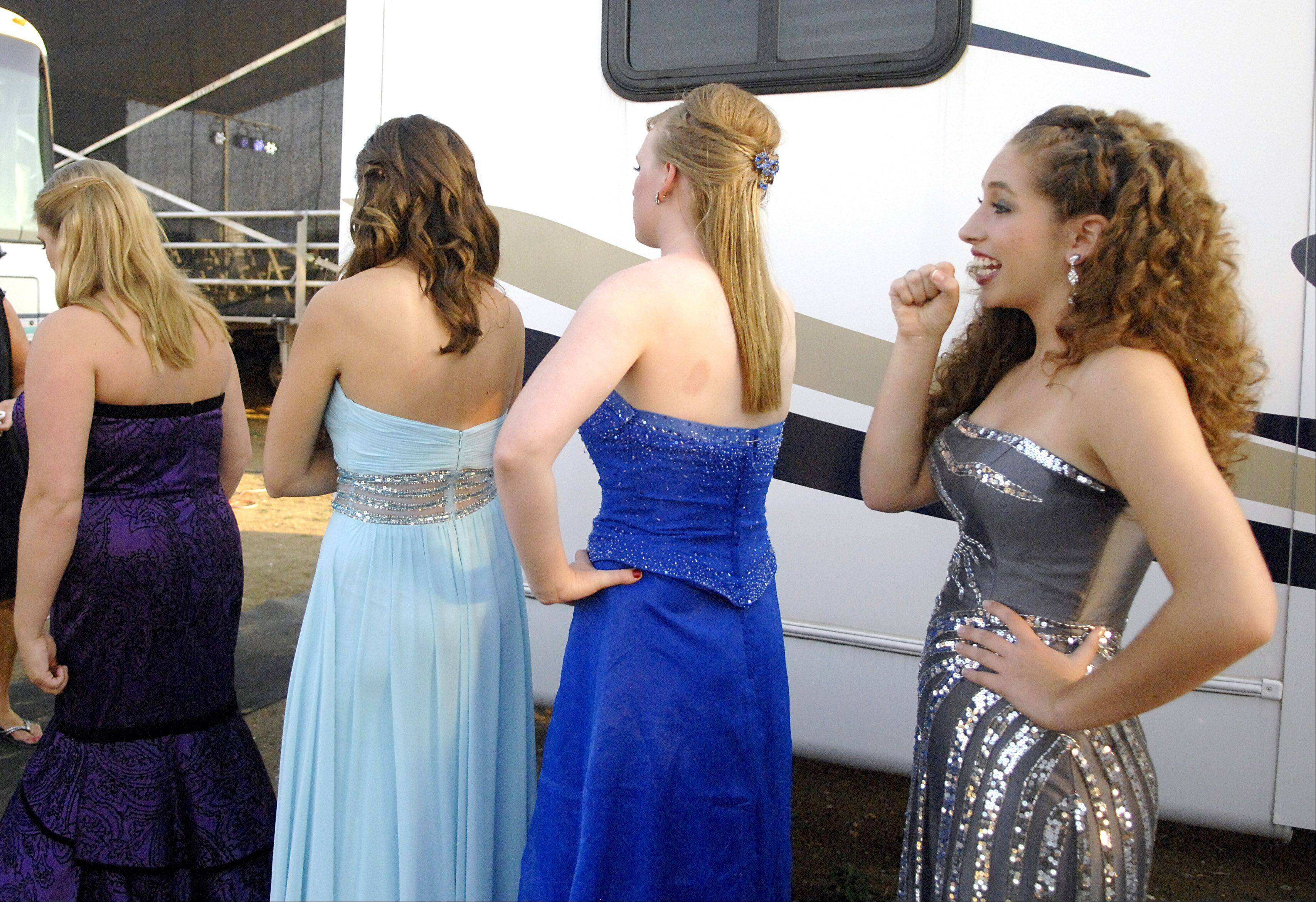Katey Kelleher, 17, of Cary practices her speech behind mobile trailers during the 2012 Miss McHenry County pageant.