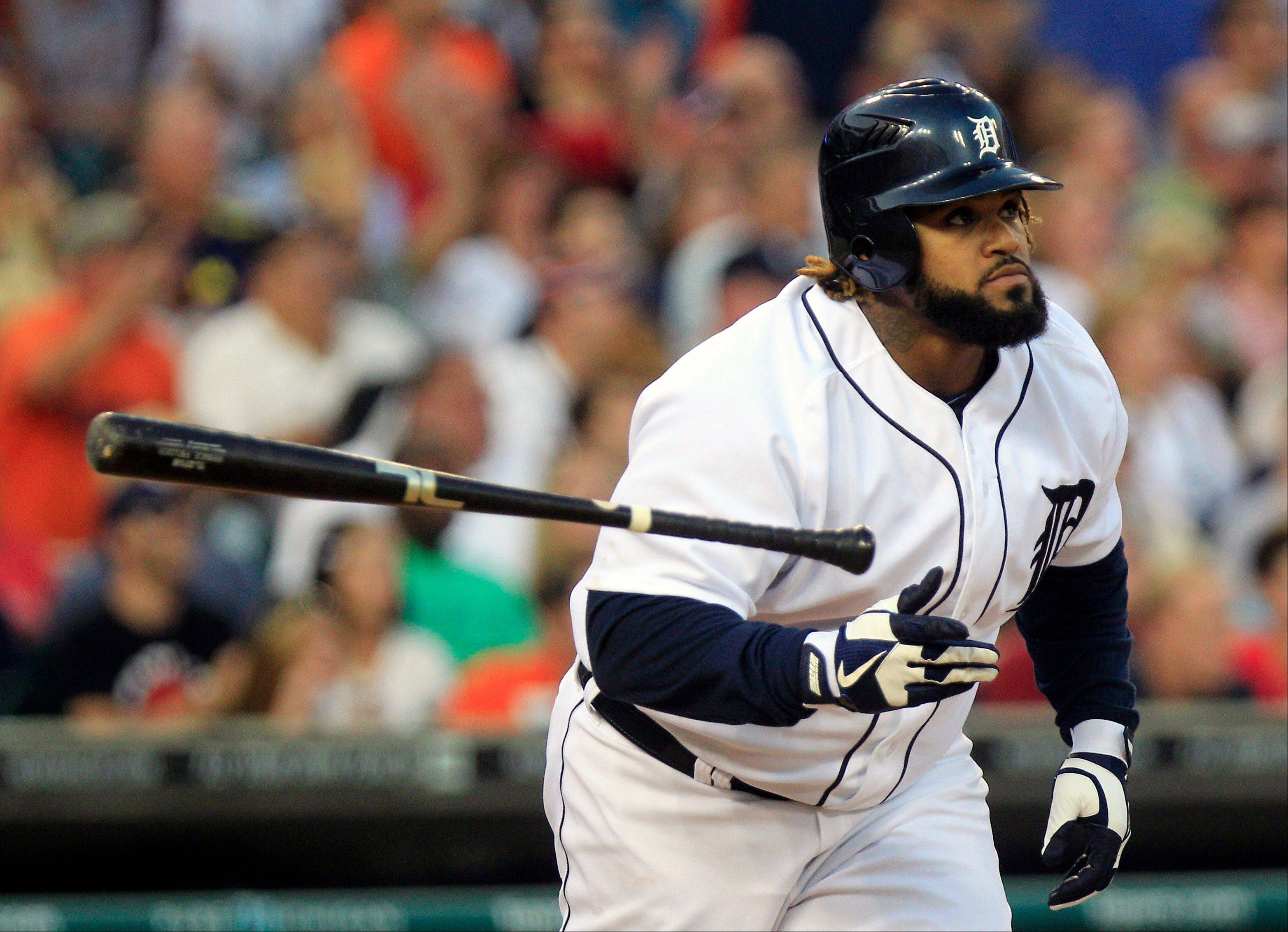 Detroit's Prince Fielder tosses his bat after hitting a two-run home run during the fourth inning of Friday's game in Cleveland.