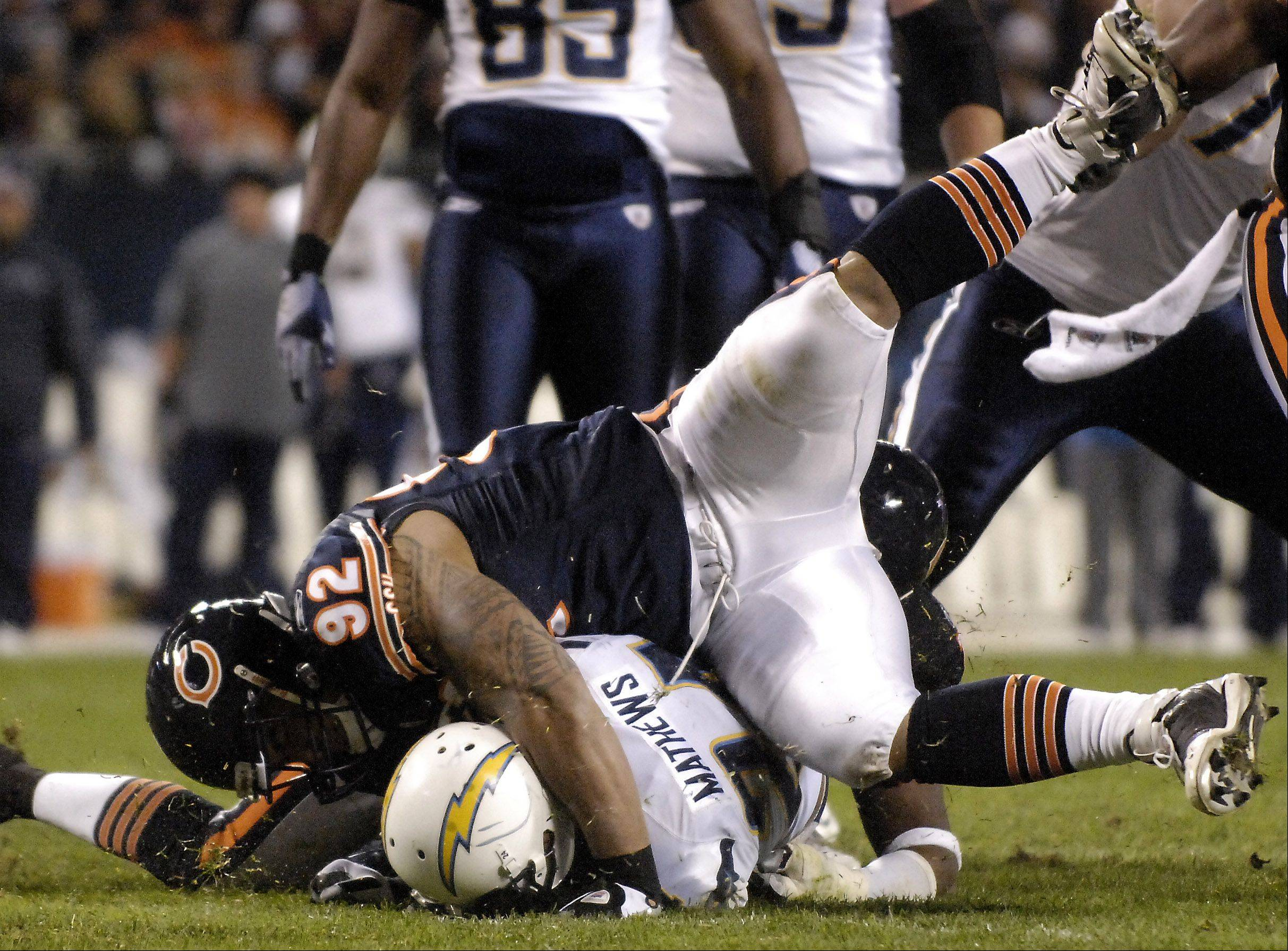 Rick West/rwest@dailyherald.com ¬ Chicago Bears defensive tackle Stephen Paea (92) drives San Diego Chargers running back Ryan Mathews (24) into the ground for no gain during Sunday's game at Soldier Field in Chicago. ¬