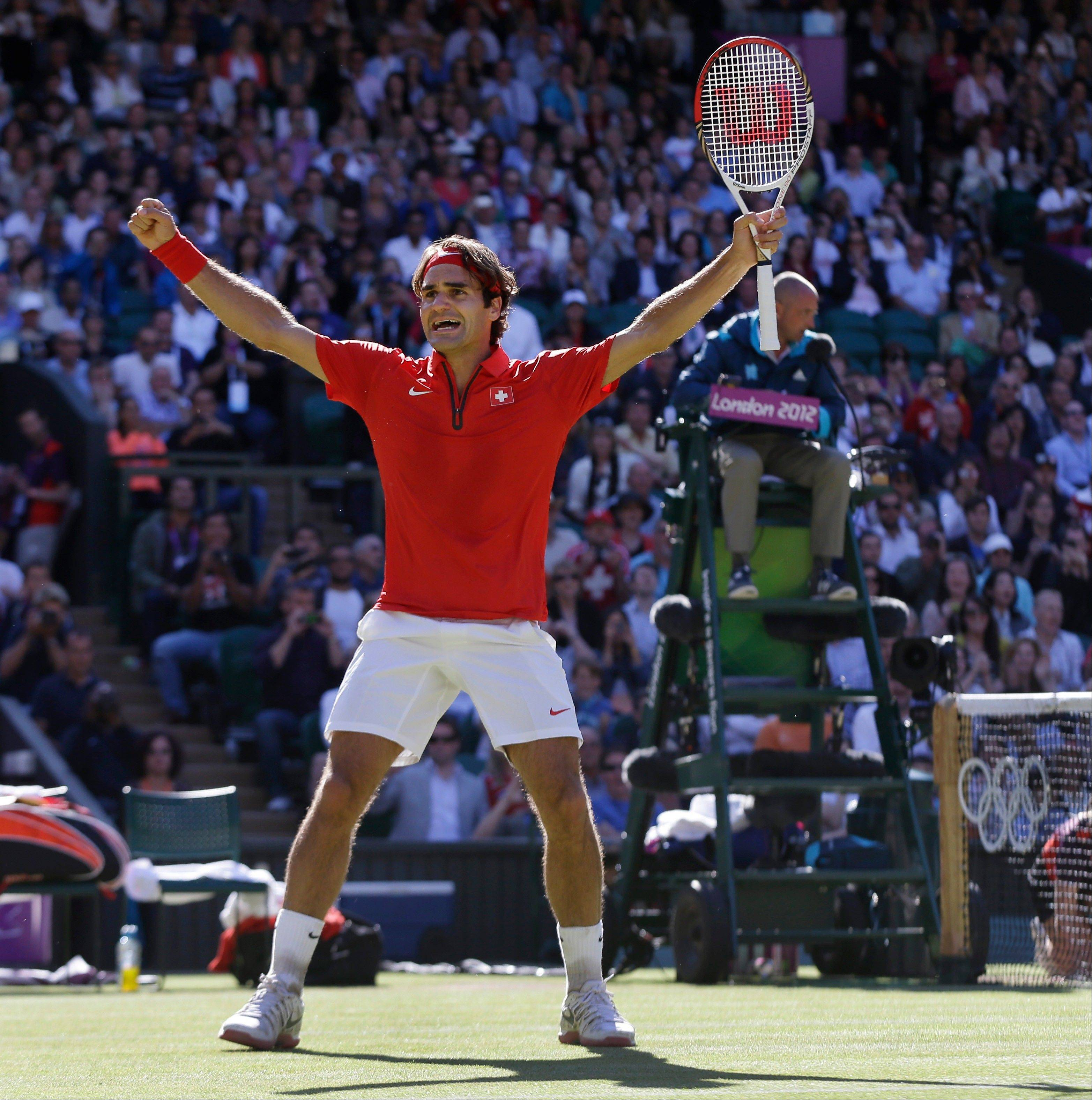Roger Federer celebrates Friday after defeating Juan Martin del Potro in the Olympic semifinal at the All England Lawn Tennis Club in Wimbledon.