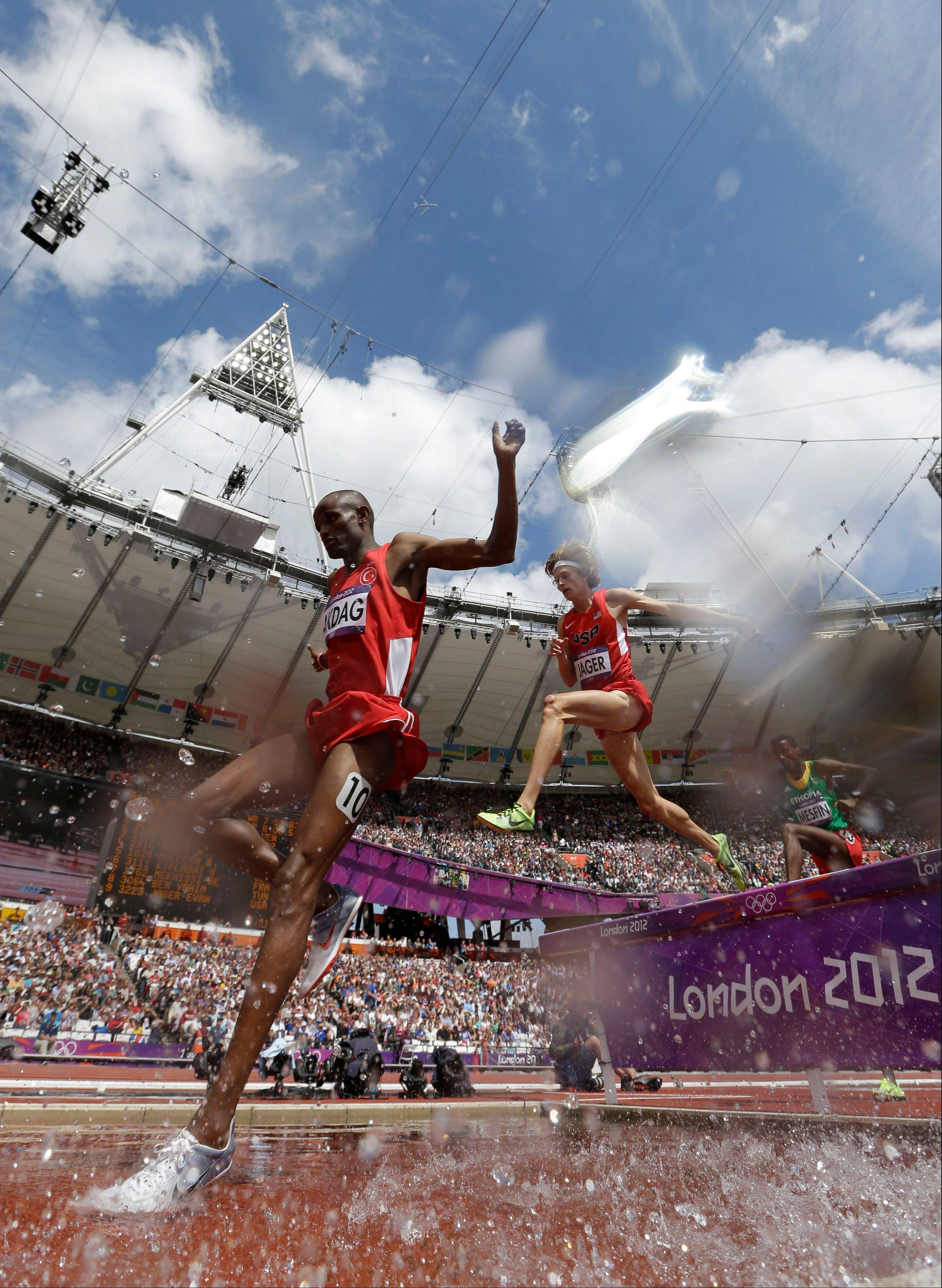 United States' Evan Jager, right, and Turkey's Tarik Langat Akdag compete in a men's 3000-meter steeplechase heat during the athletics in the Olympic Stadium at the 2012 Summer Olympics, London, Friday, Aug. 3, 2012.