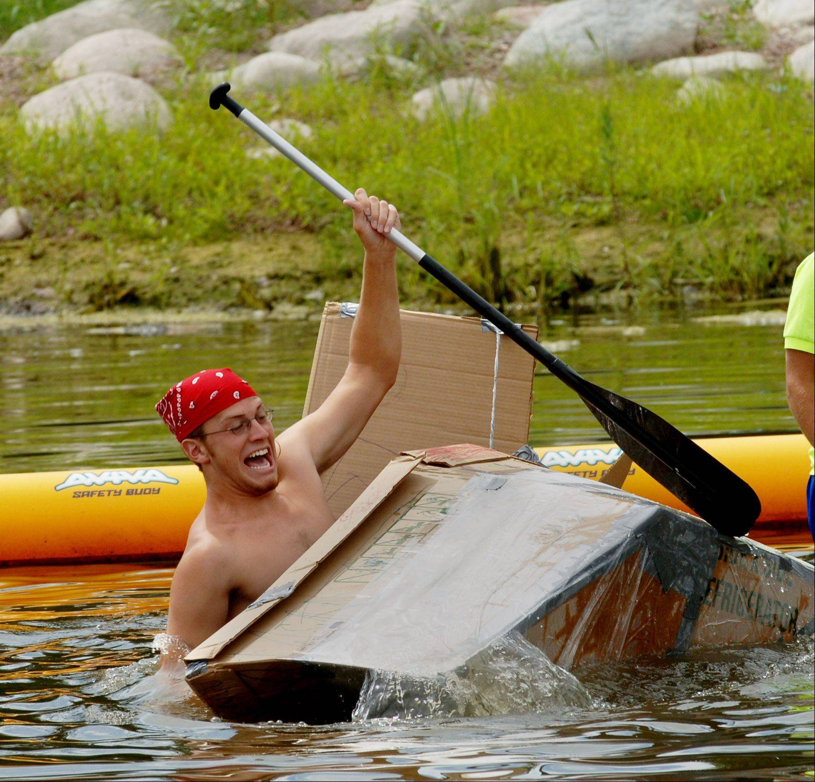 Gurnee Park District camp counselors will race again in cardboard boats at Hunt Club Park Aquatic Center. In 2008, this boater struggled to stay afloat when the race was held at Gowe Beach in Gurnee.