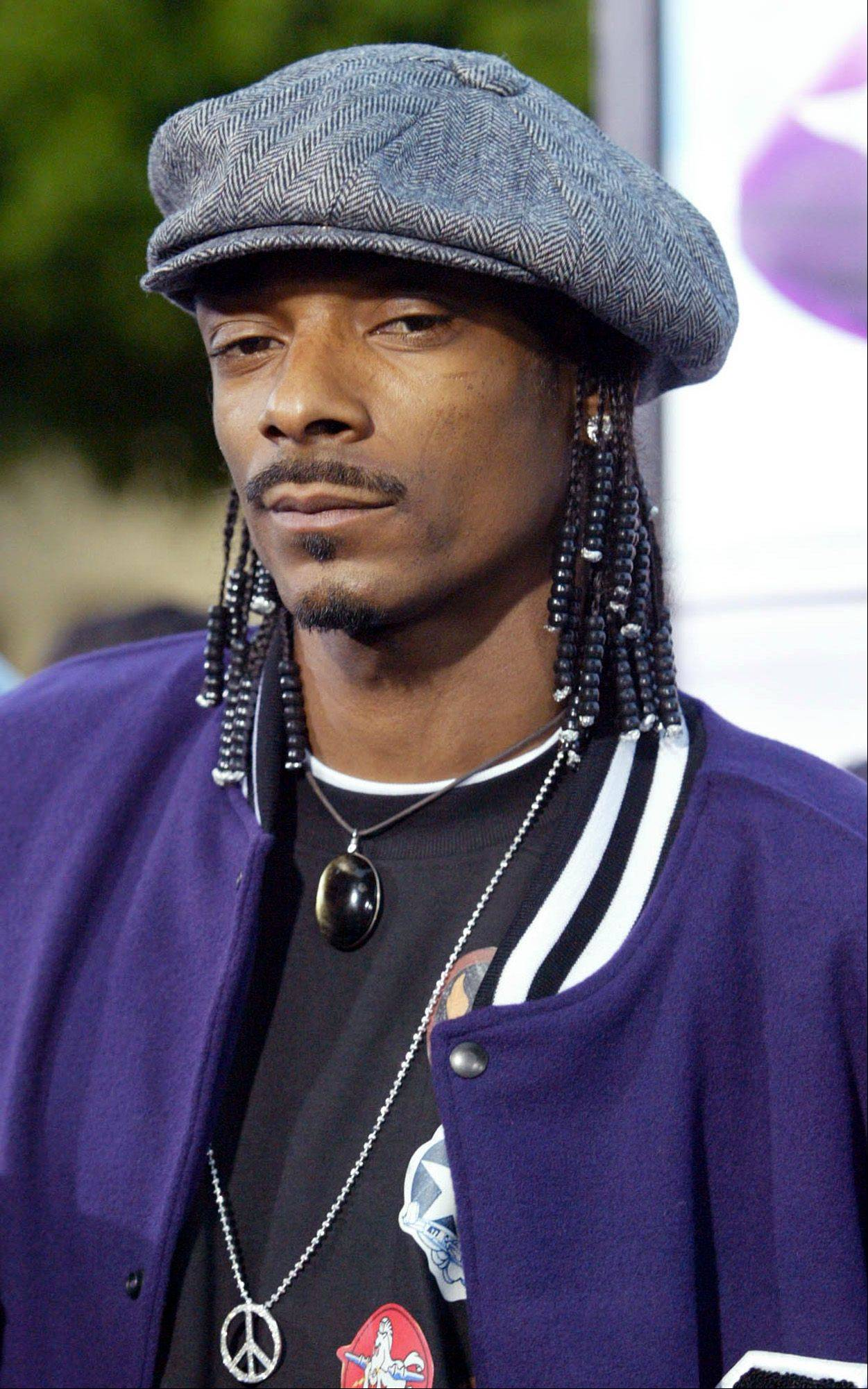 Actor and singer Snoop Dog, shown in this May 17, 2004, file photo in Los Angeles, has announced that he will change his name to Snoop Lion and will transform himself into a reggae artist.