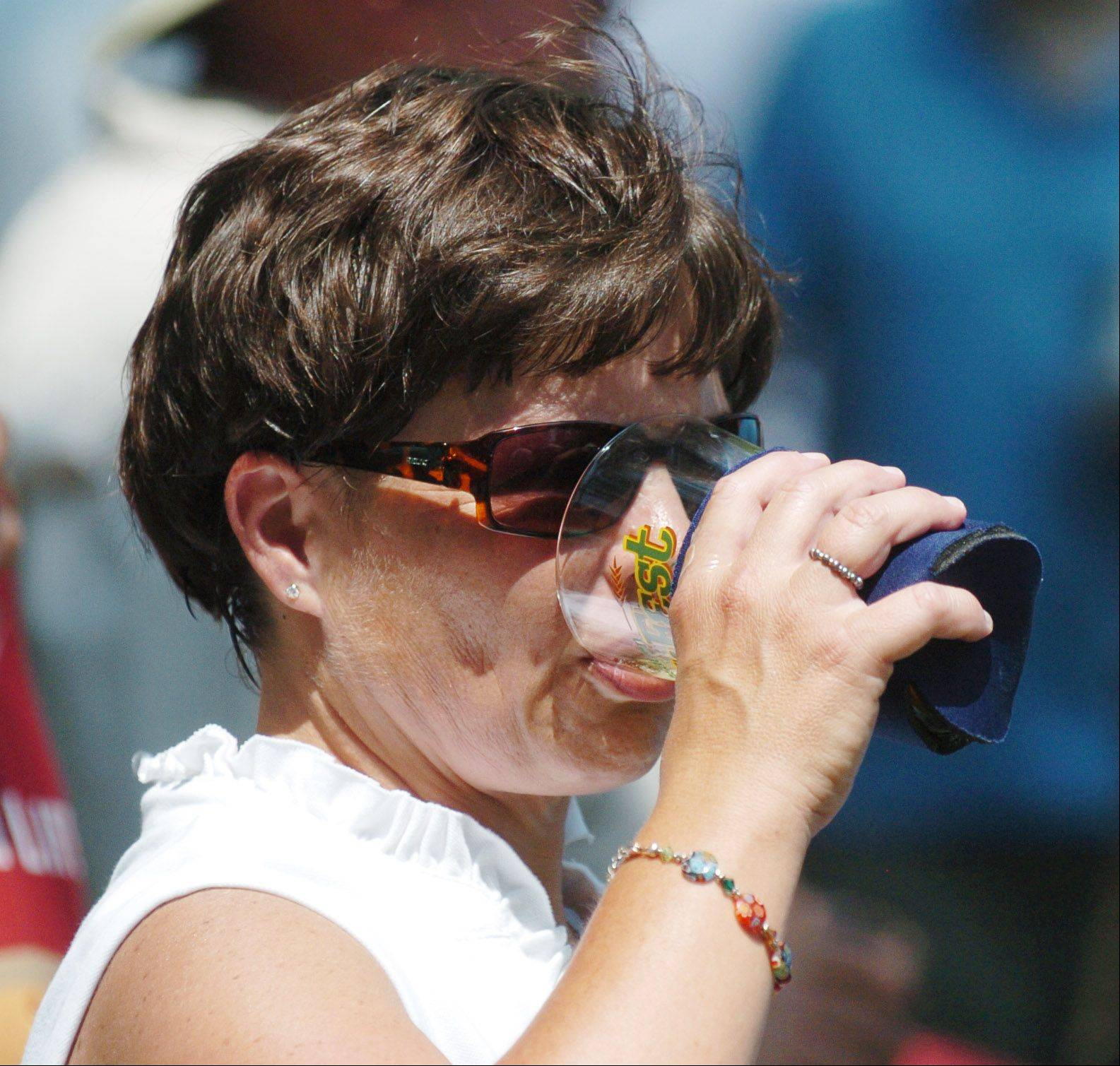 Ellen Borys of Lombard enjoys a beer sample Saturday during the second annual Wheaton Ale Fest at Memorial Park. The afternoon event offered samples of beers from 53 breweries.