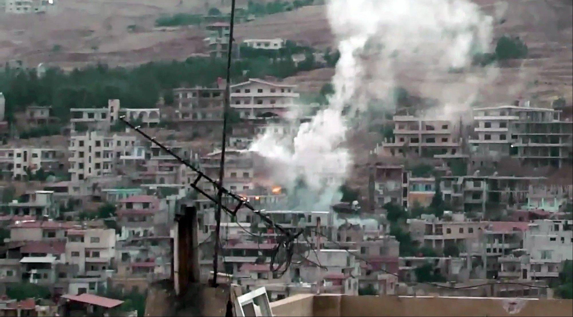 In this citizen journalism image provided by Shaam News Network SNN, taken on Saturday, Aug. 4, 2012, purports to show shelling in Zabadani, near Damascus, Syria.