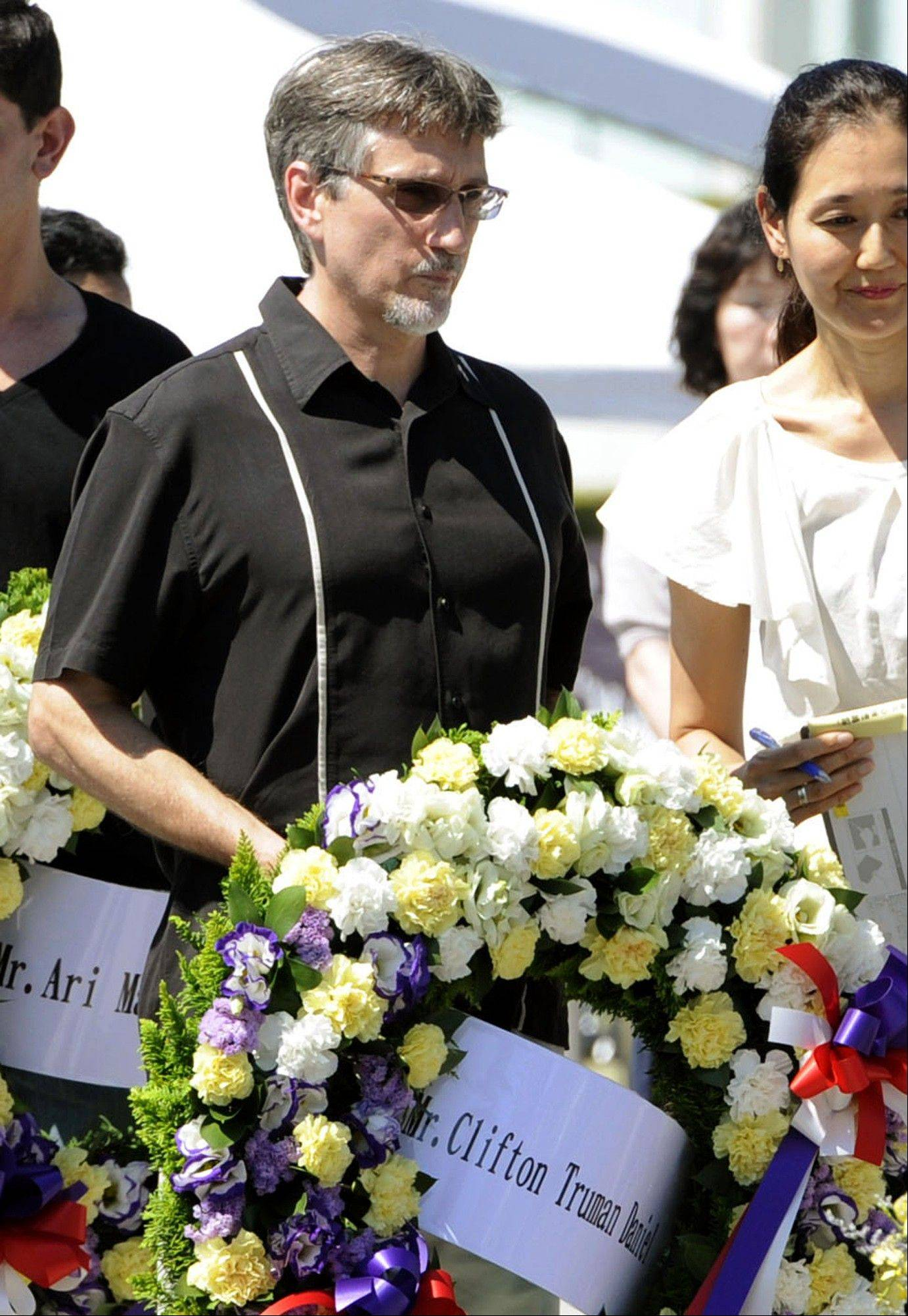 Clifton Truman Daniel, a grandson of former U.S. President Harry Truman, prepares for a wreath-laying at the Hiroshima Peace Memorial Park in Hiroshima, Japan, Saturday, Aug. 4, 2012. Daniel, whose first visit to Japan was sponsored by a Japanese peace group, paid respect Saturday to the 140,000 people killed by the Aug. 6, 1945 bombing authorized by his grandfather.