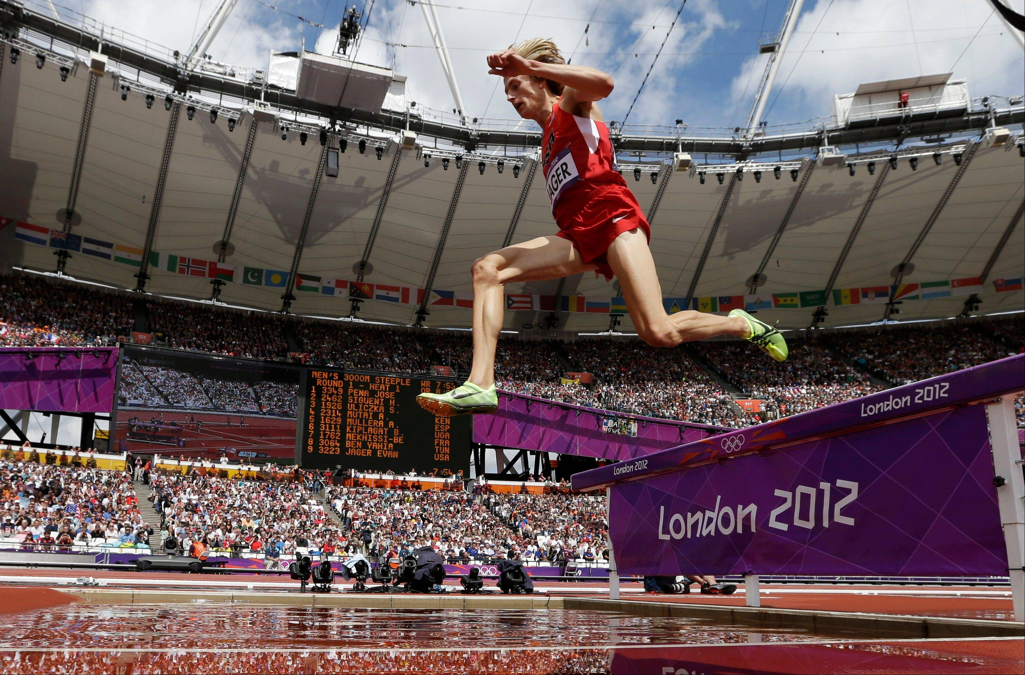 United States' Evan Jager competes in a men's 3000-meter steeplechase heat during the athletics in the Olympic Stadium at the 2012 Summer Olympics, London, Friday, Aug. 3, 2012. (AP Photo/David J. Phillip )