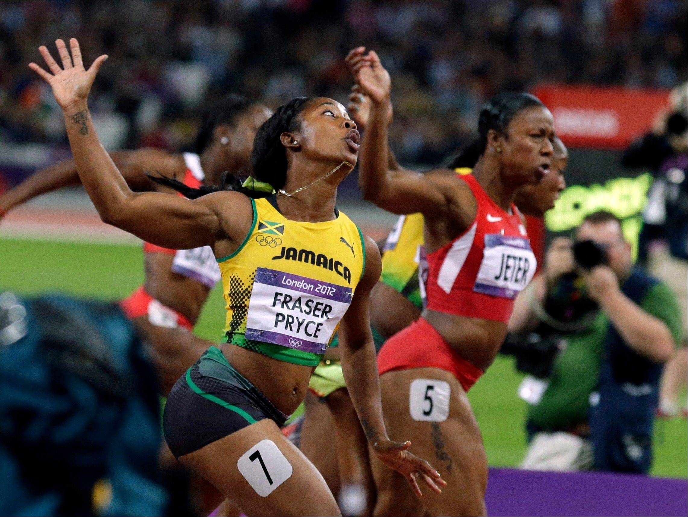 Jamaica�s Shelly-Ann Fraser-Pryce, left, crosses the finish line ahead of the United States� Carmelita Jeter Saturday during the women�s 100-meter final during at the Olympic Stadium. Fraser-Pryce won the gold, Jeter finished second.