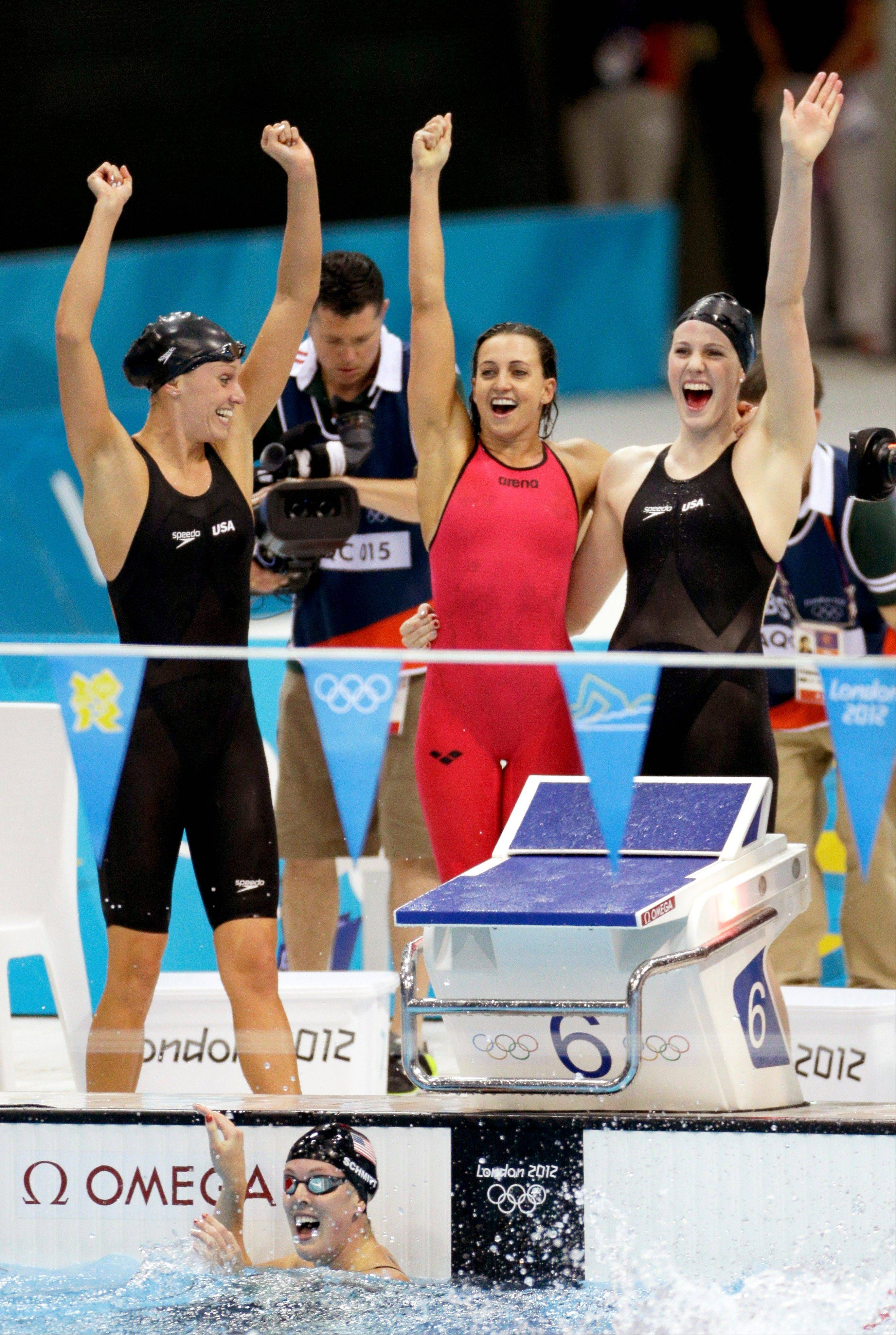 The United States� women�s 4 x 100-meter medley relay team members from left, Dana Vollmer, Rebecca Soni, Missy Franklin and Alison Schmitt, bottom, celebrate Saturday after winning the gold medal at the Aquatics Centre in the Olympic Park.
