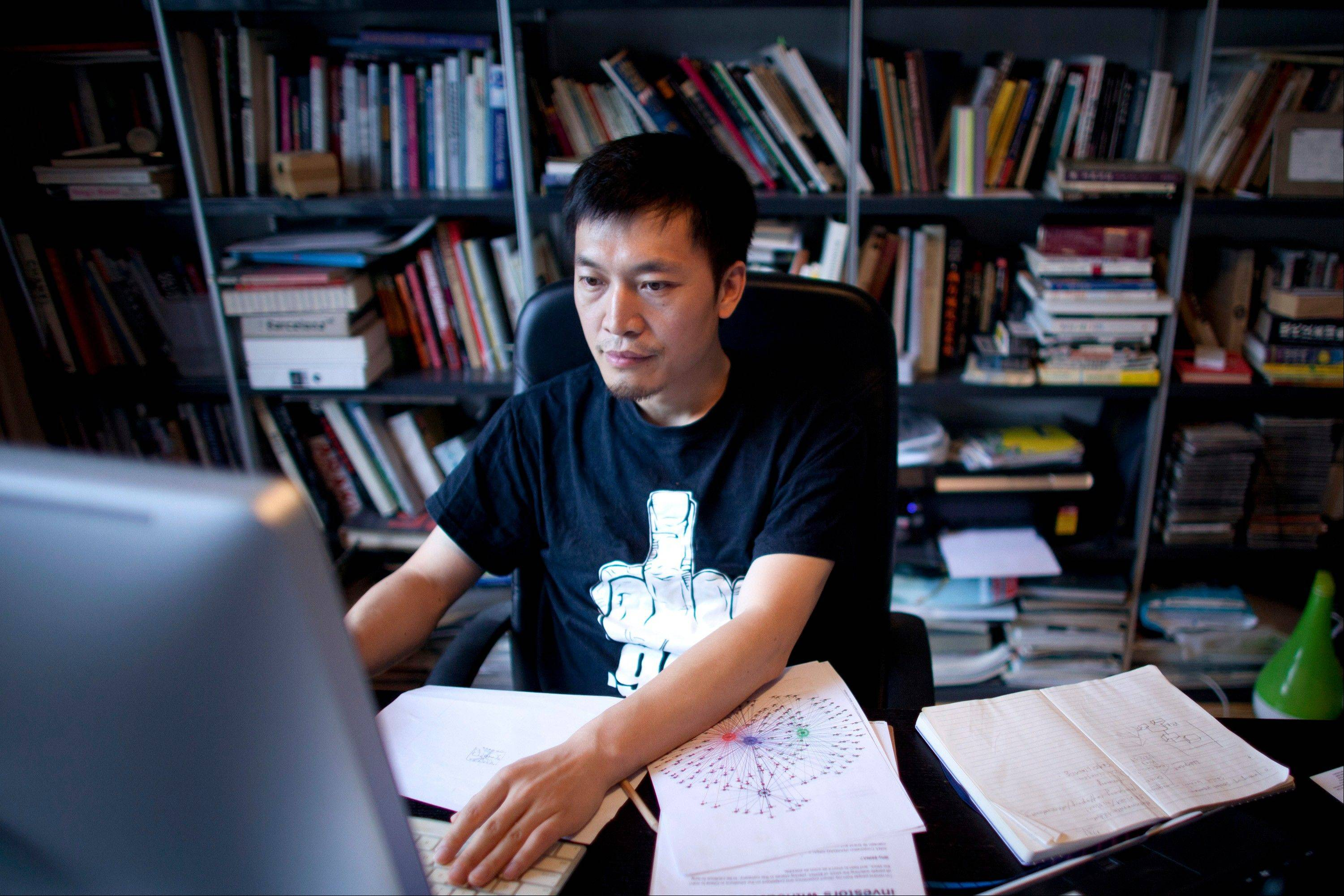 Isaac Mao, a well-known Chinese blogger and the founder of Sharism Lab, a social media research group, works on a computer in Beijing. Mao had more than 30,000 users when his Weibo account was deleted in June after he made a series of questioning remarks about China's space program.