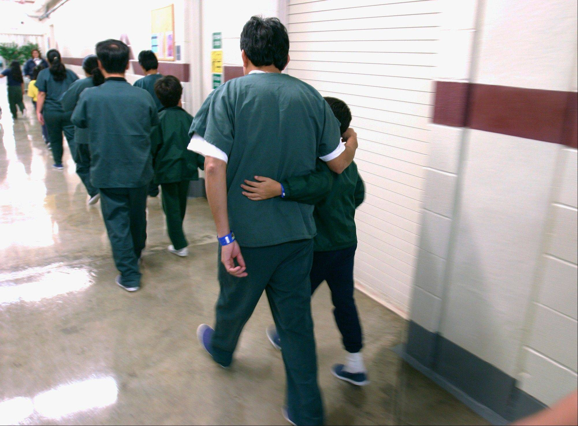 Family detainees walk down the hall at the T. Don Hutto Residential Center in Taylor, Texas.
