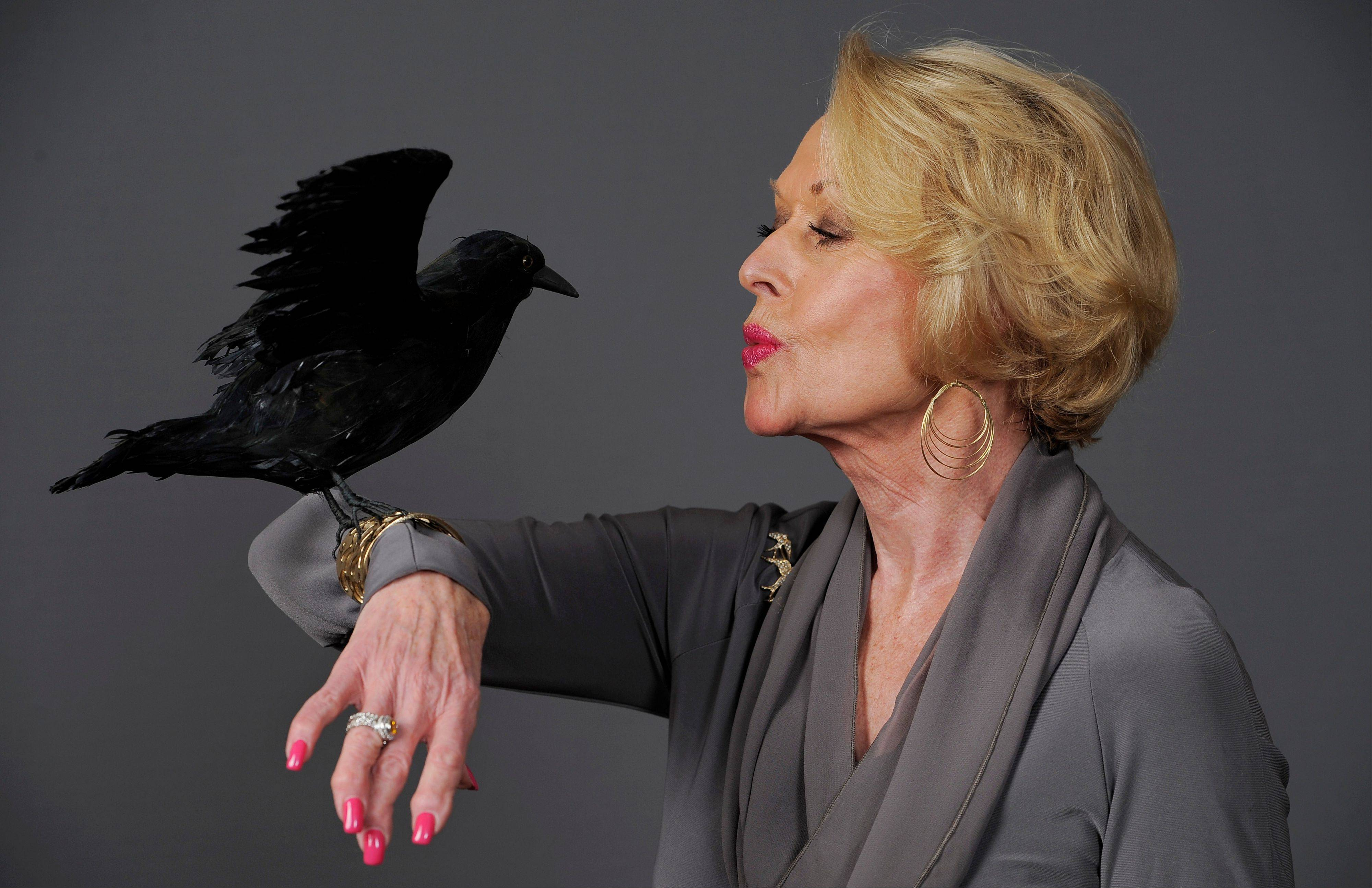 "Actress Tippi Hedren, star of the 1963 Alfred Hitchcock film ""The Birds,"" poses with a prop bird Aug. 1 in Beverly Hills, Calif. Hedren's relationship with Hitchcock during the making of ""The Birds"" and ""Marnie"" is the subject of the HBO film ""The Girl."" Hedren says she survived working with Alfred Hitchcock, but her career was another matter."