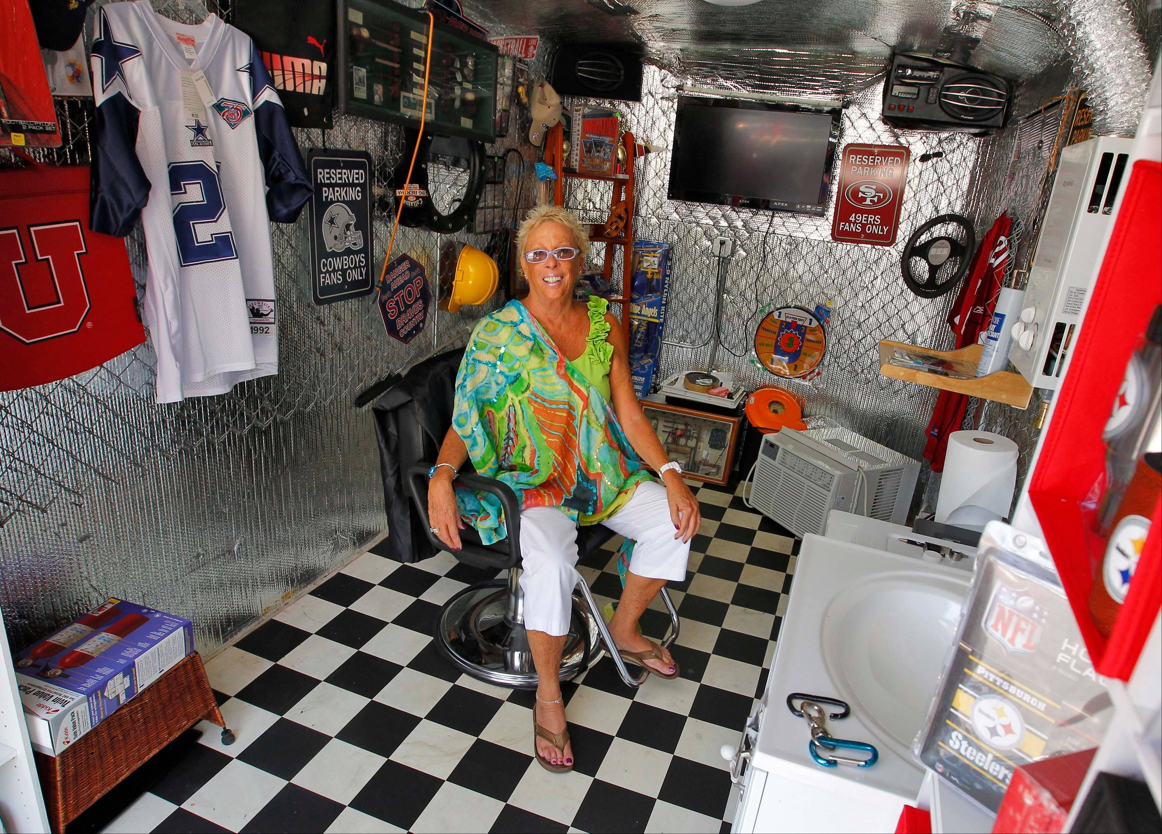 Julia Hutton sits inside her custom trailer July 31 in Phoenix. Hutton owns ExTreme ReTrailers, which designs custom trailers to look like mini stores on wheels. The trailers include wireless credit card machines, changing rooms and air conditioning. Hutton is among a handful of mobile retails stores across the U.S. hocking vintage accessories, sexy shoes and denim to die for in their haute wheels.