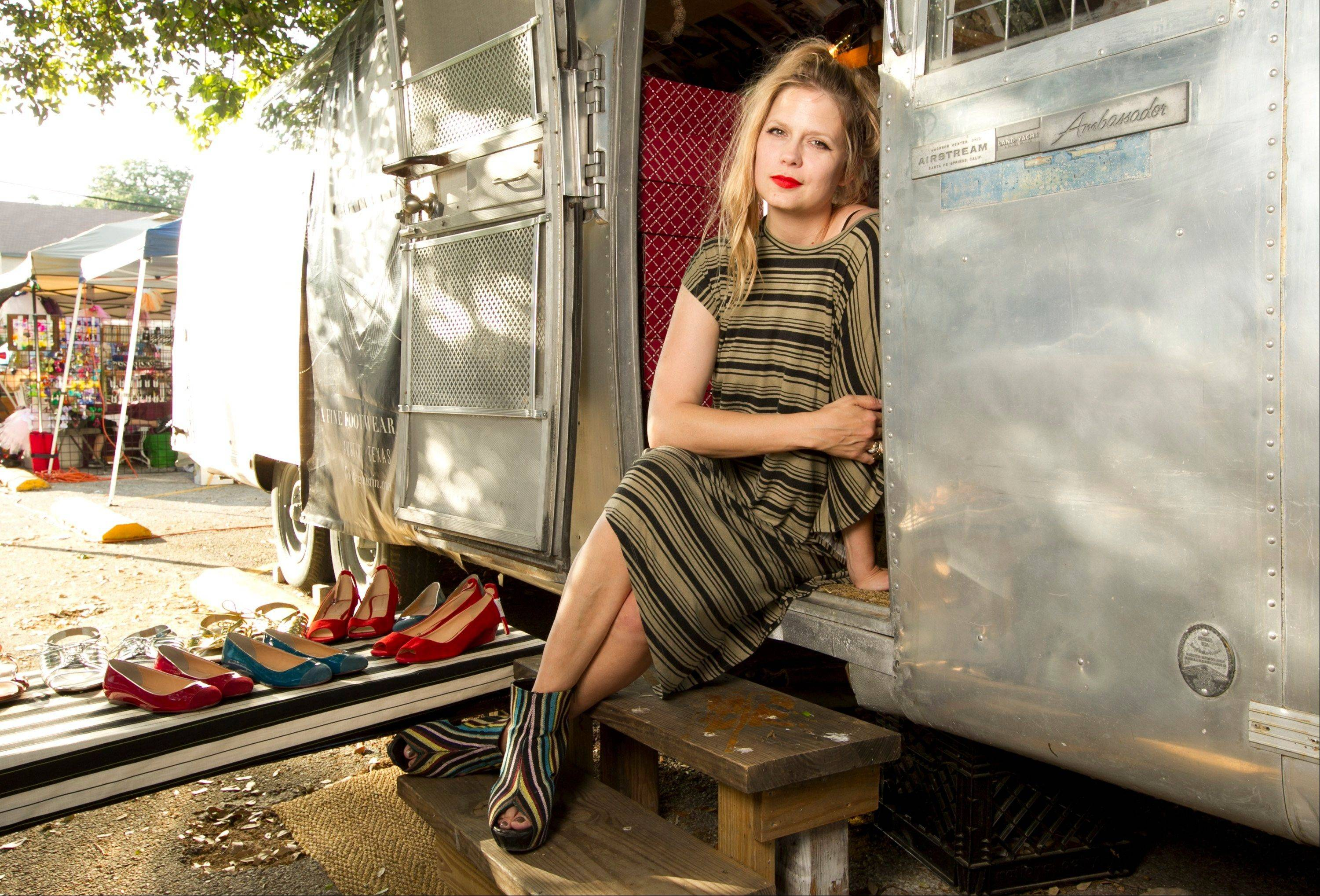 Sarah Ellison Lewis, the owner of Bootleg, a shoe trailer with hard-to-find footwear labels poses in Austin, Texas, on April 5. When the former fashion editor wanted to open an upscale, funky shoe boutique, she had sticker shock every time she saw the price for a store lease. She worried the hefty rent would limit her ability to turn a profit so she bought a 30-foot trailer, decorated it with vintage wallpaper photography and reclaimed wooden benches and signed a lease on a parking spot between a chic hotel and popular brunch spot in an eclectic neighborhood for a quarter of the cost of a traditional store.