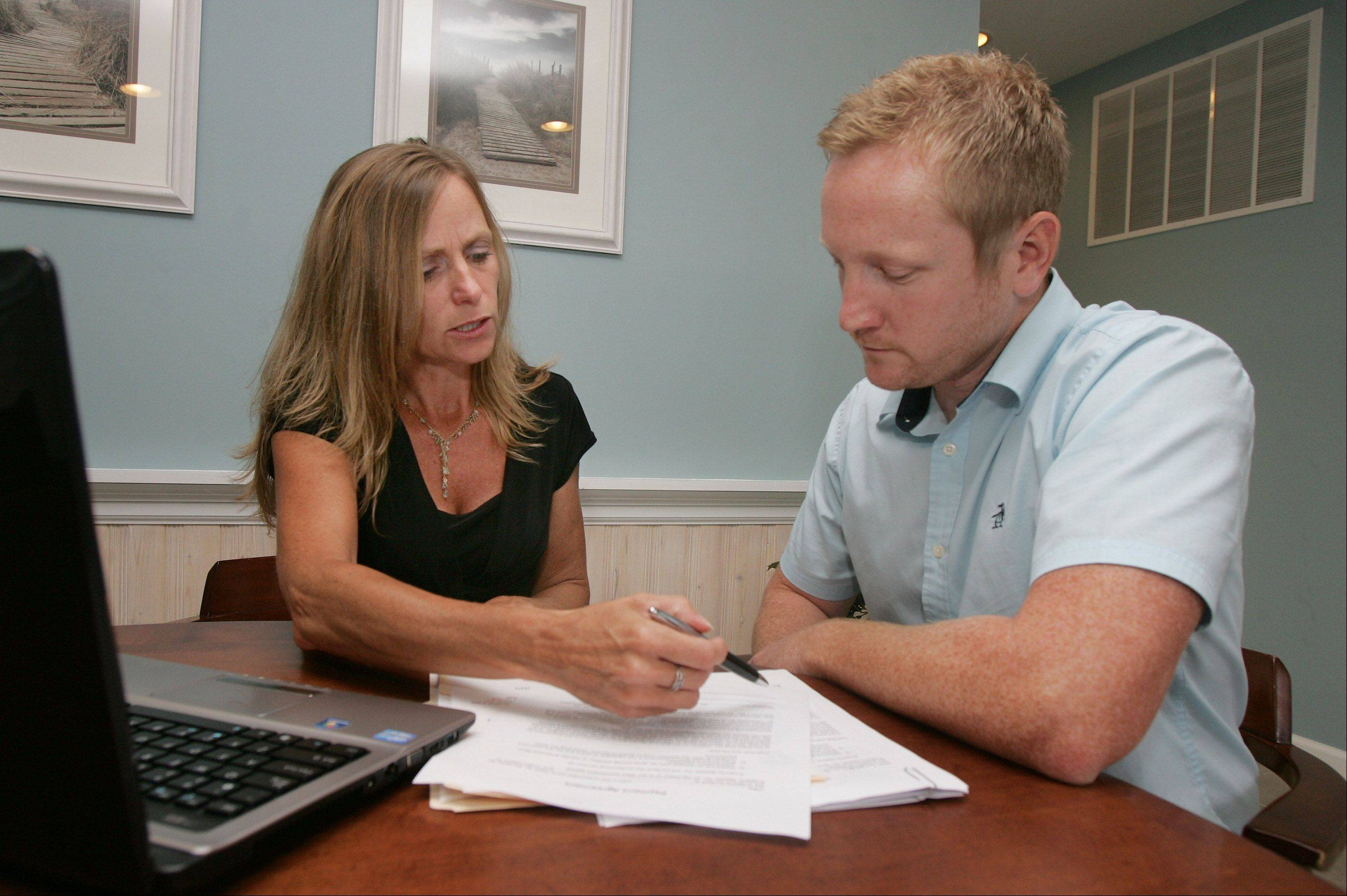 Property Appeal Inc. owner Stephanie Seiwerth works at her office in Wauconda with a client, Shawn Bergfalk, on a tax assessment he is appealing.