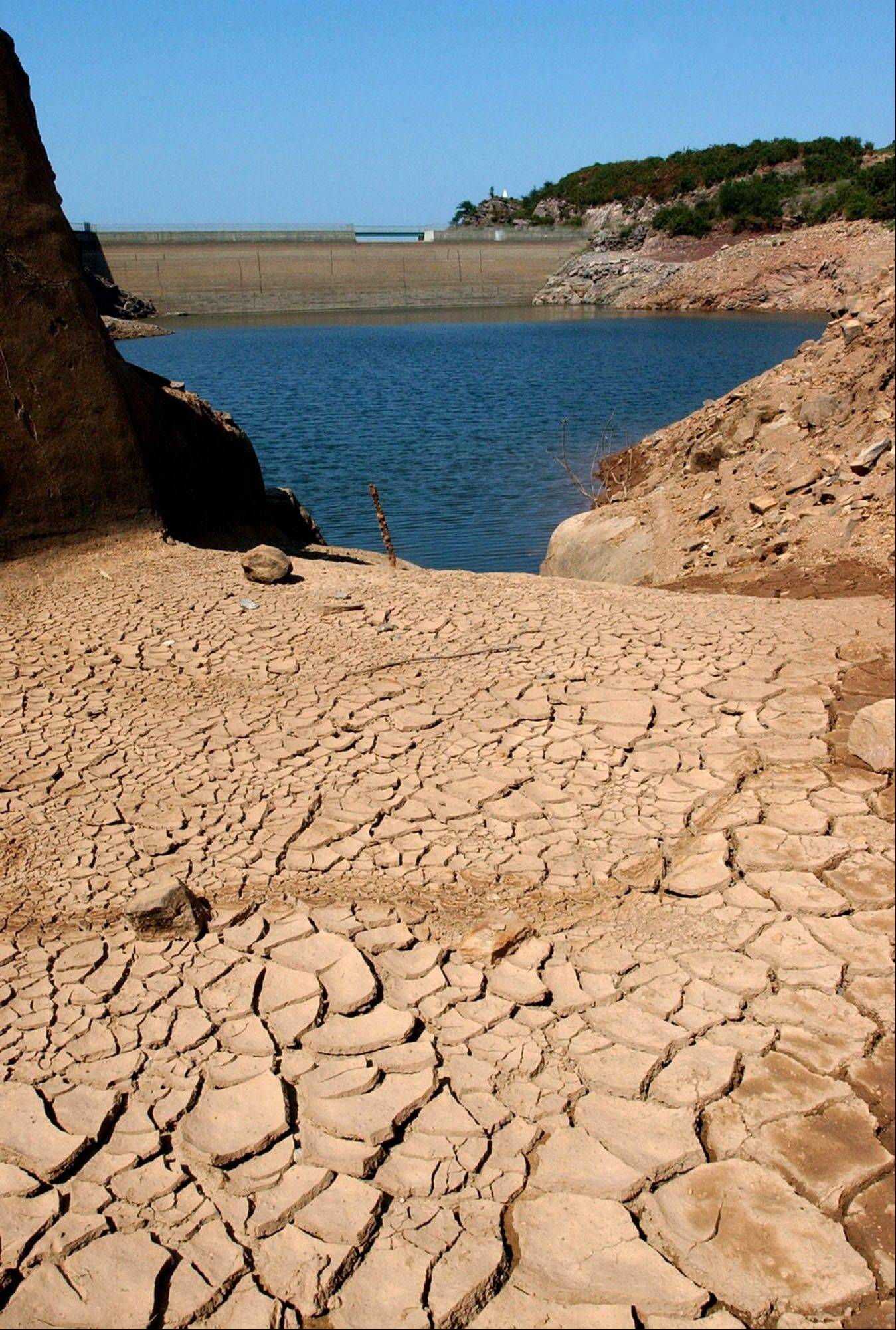 "In this Aug. 19, 2003 file photo, the Ibardin lake, which provides drinking water to the southern French cities of Hendaye, Biriatu and Urrugne, is almost dry due to the recent heat wave, near the French-Spanish border. ""Rather than say, 'Is this because of climate change?' That's the wrong question. What you can say is, `How likely is this to have occurred with the absence of global warming?' It's so extraordinarily unlikely that it has to be due to global warming,"" says Andrew Weaver, a climate scientist at the University of Victoria in British Columbia."