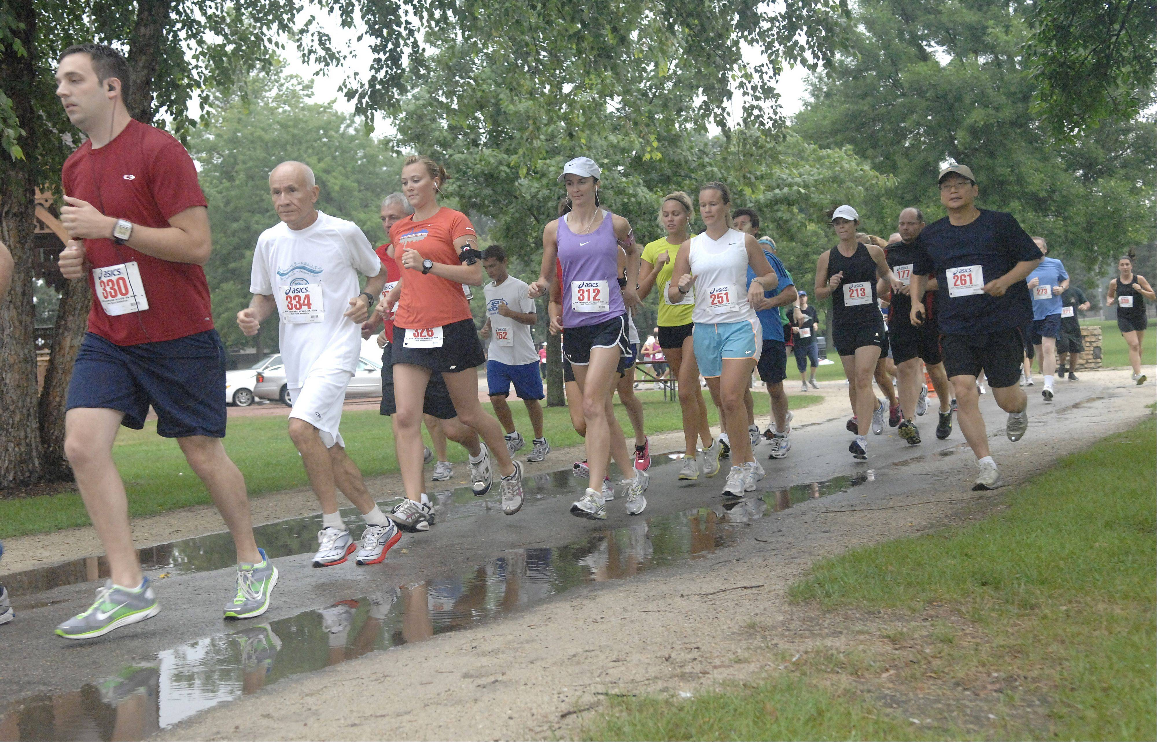 Runners take off at last year's Bob Leonard 5K Run and Walk-A-Thon at Pottawatomie Park in St. Charles. This year's event is Saturday, Aug. 11, and benefits the River Corridor Foundation. Leonard was a founder of the group and an advocate for riverfront beautification.
