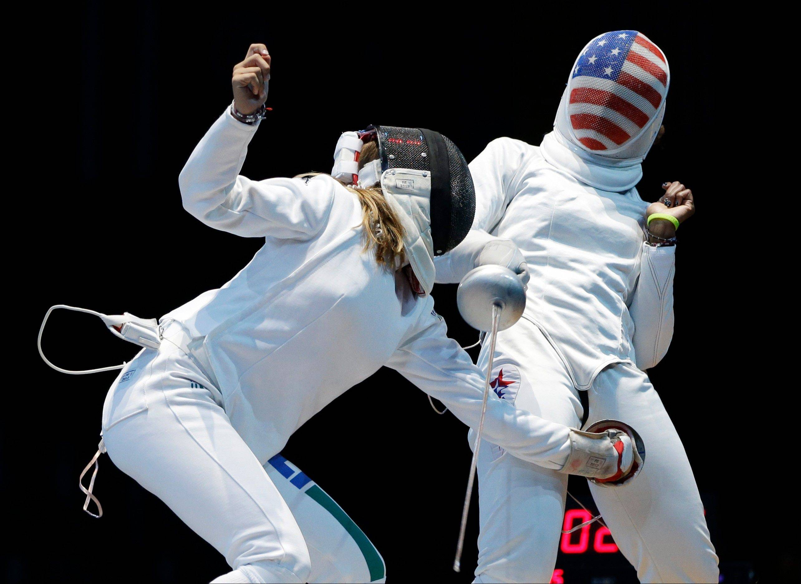 Italy's Rossella Fiamingo, left, competes against the United States' Maya Lawrence during a match in women's epee team fencing competition at the 2012 Summer Olympics, Saturday, Aug. 4, 2012, in London.