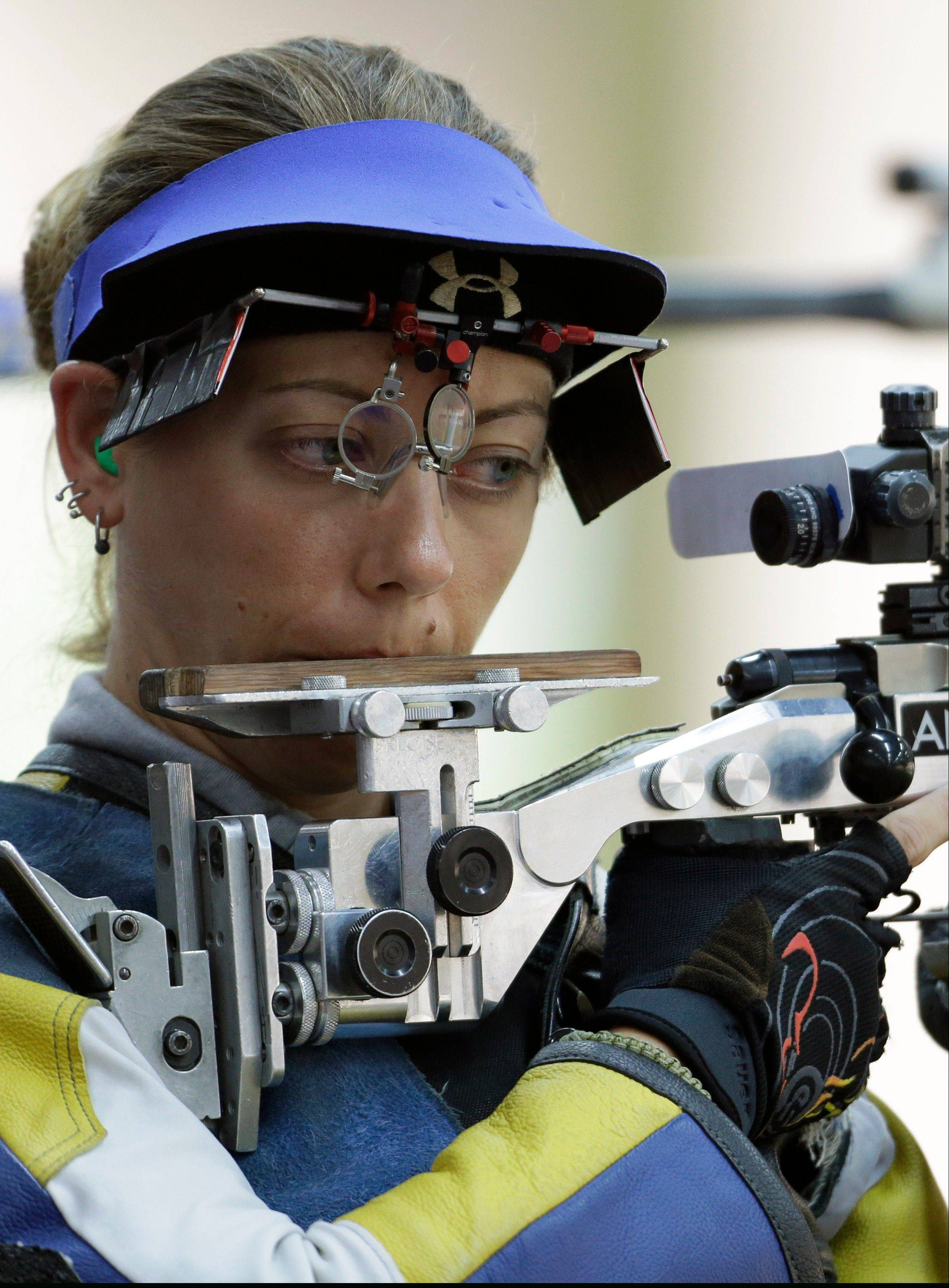United States of America's Jamie Lynn Gray, shoots during qualifiers for the women's 50-meter rifle 3 positions event, at the 2012 Summer Olympics, Saturday, Aug. 4, 2012, in London.