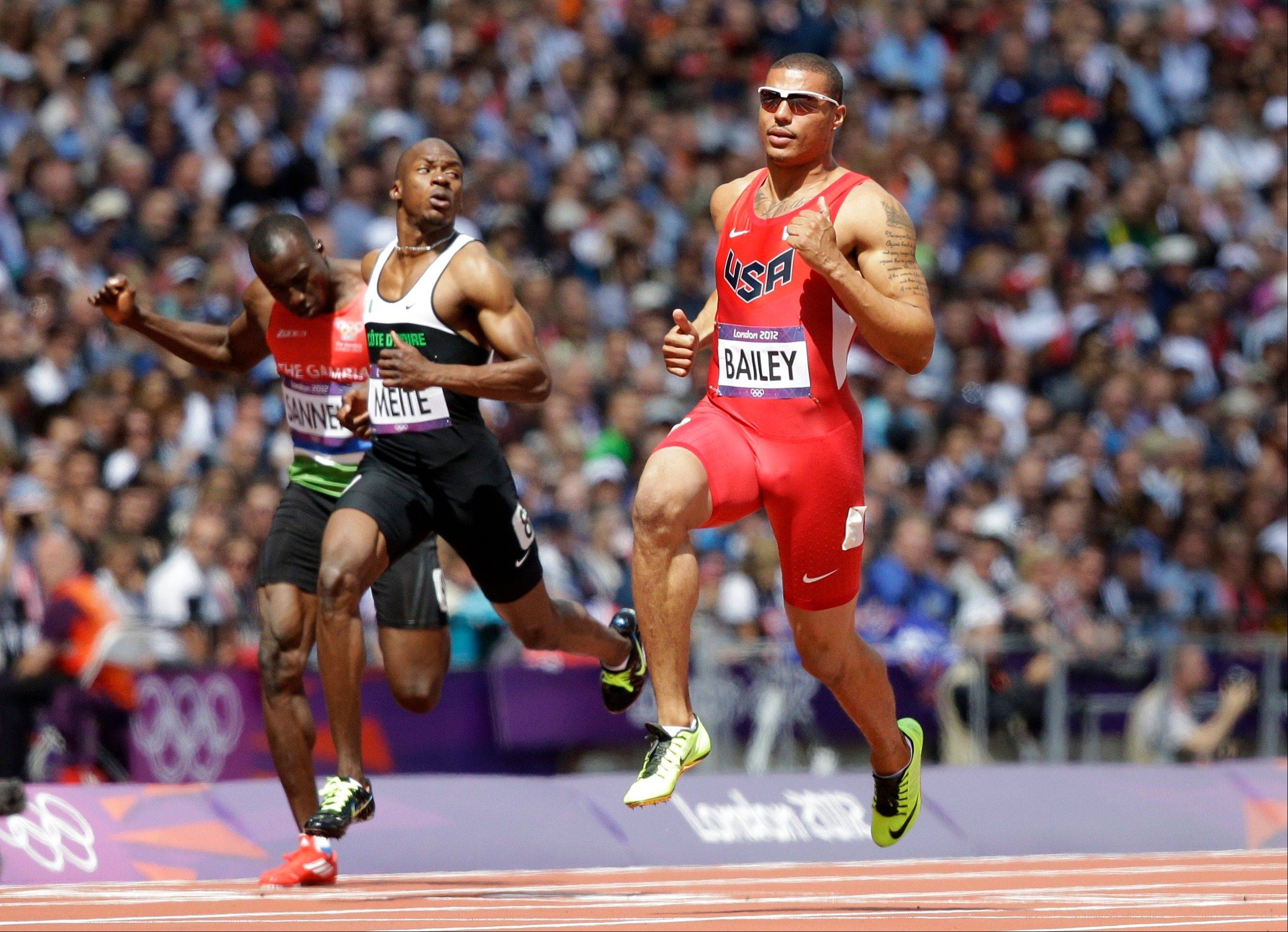 United States' Ryan Bailey, right, Ivory Coast's Ben Youssef Meite, center, and Gambia's Suwaibou Sanneh cross the finish line in a men's 100-meter heat during the athletics in the Olympic Stadium at the 2012 Summer Olympics, London, Saturday, Aug. 4, 2012.