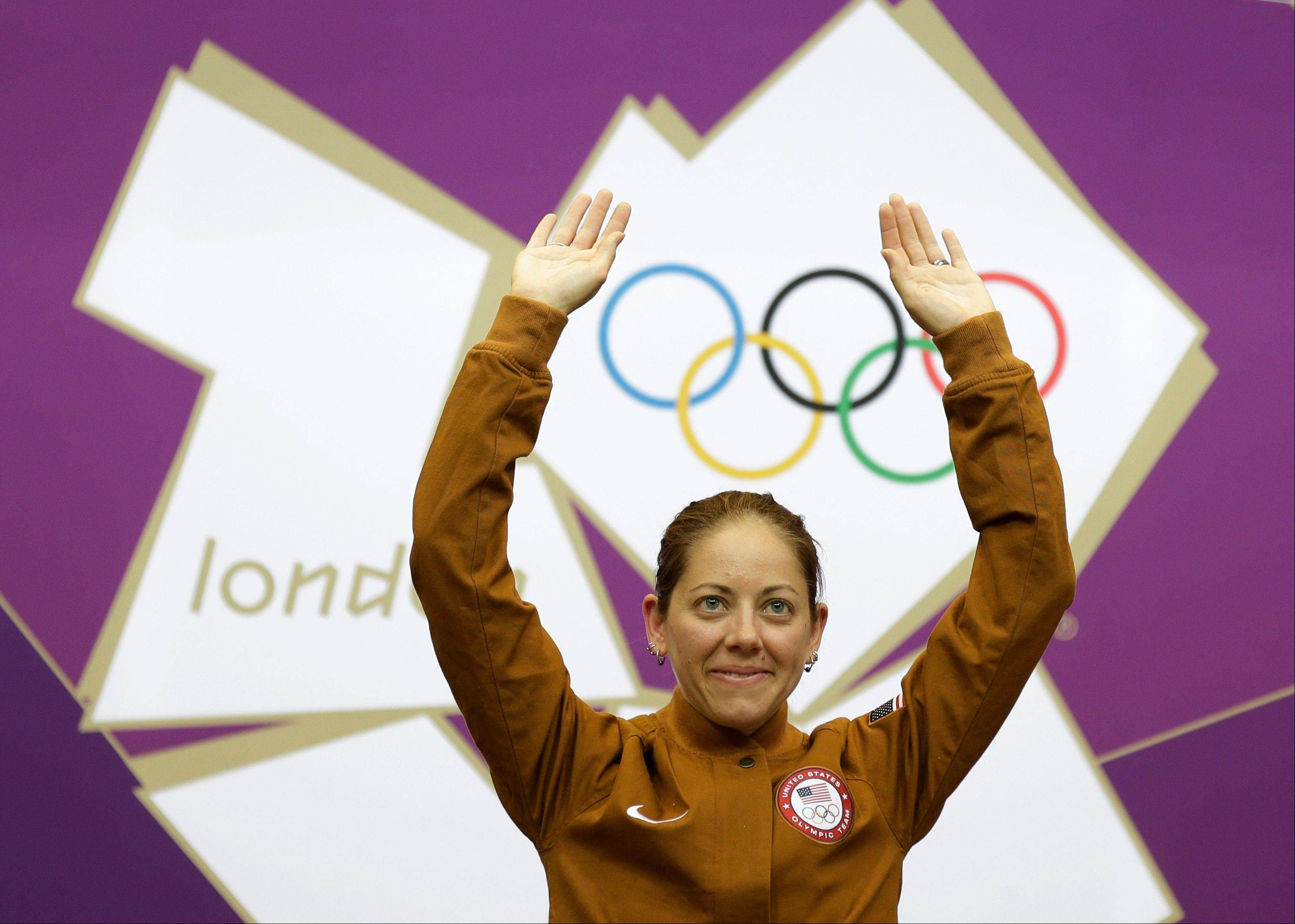 United States of America's Jamie Lynn Gray celebrates winning the gold medal in the women's 50-meter rifle 3 positions event, at the 2012 Summer Olympics, Saturday, Aug. 4, 2012, in London.