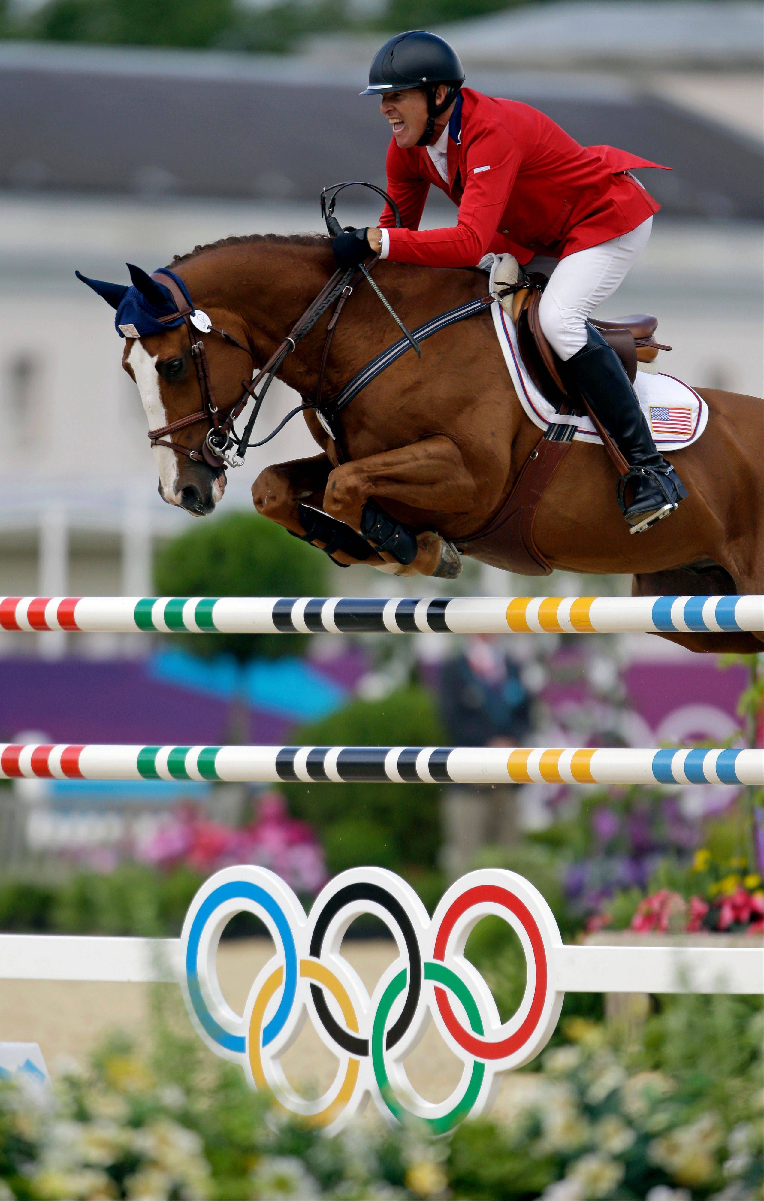 Richard Fellers, of the United States, rides Flexible during the equestrian individual show jumping competition at the 2012 Summer Olympics, Saturday, Aug. 4, 2012, in London.