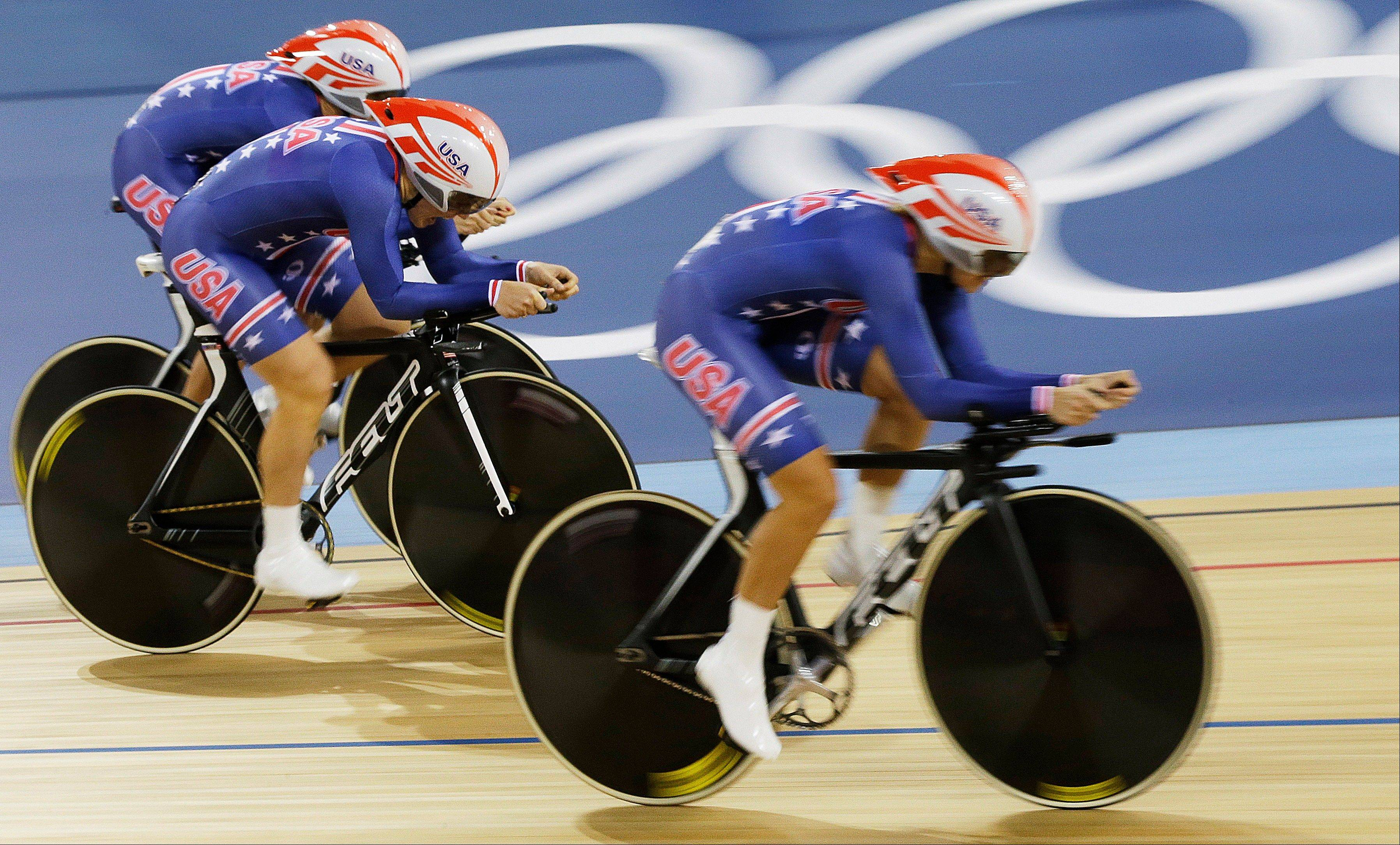 The United States' team competes during a women's pursuit team track cycling event in the velodrome during the 2012 Summer Olympics, Saturday, Aug. 4, 2012, in London.