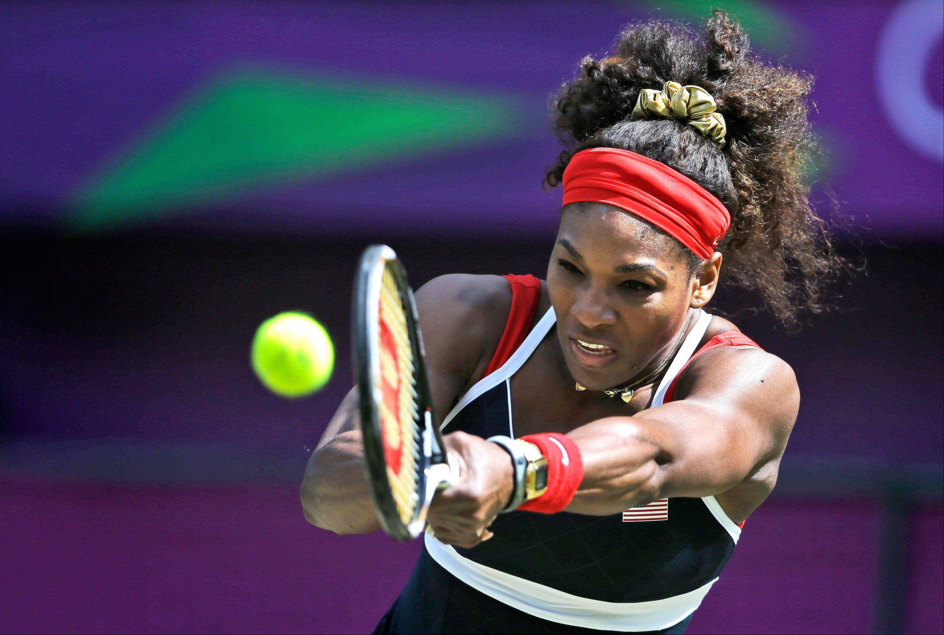 United States' Serena Williams returns a shot to Maria Sharapova of Russia in the women's singles gold medal match at the All England Lawn Tennis Club at Wimbledon, in London, at the 2012 Summer Olympics, Saturday, Aug. 4, 2012.