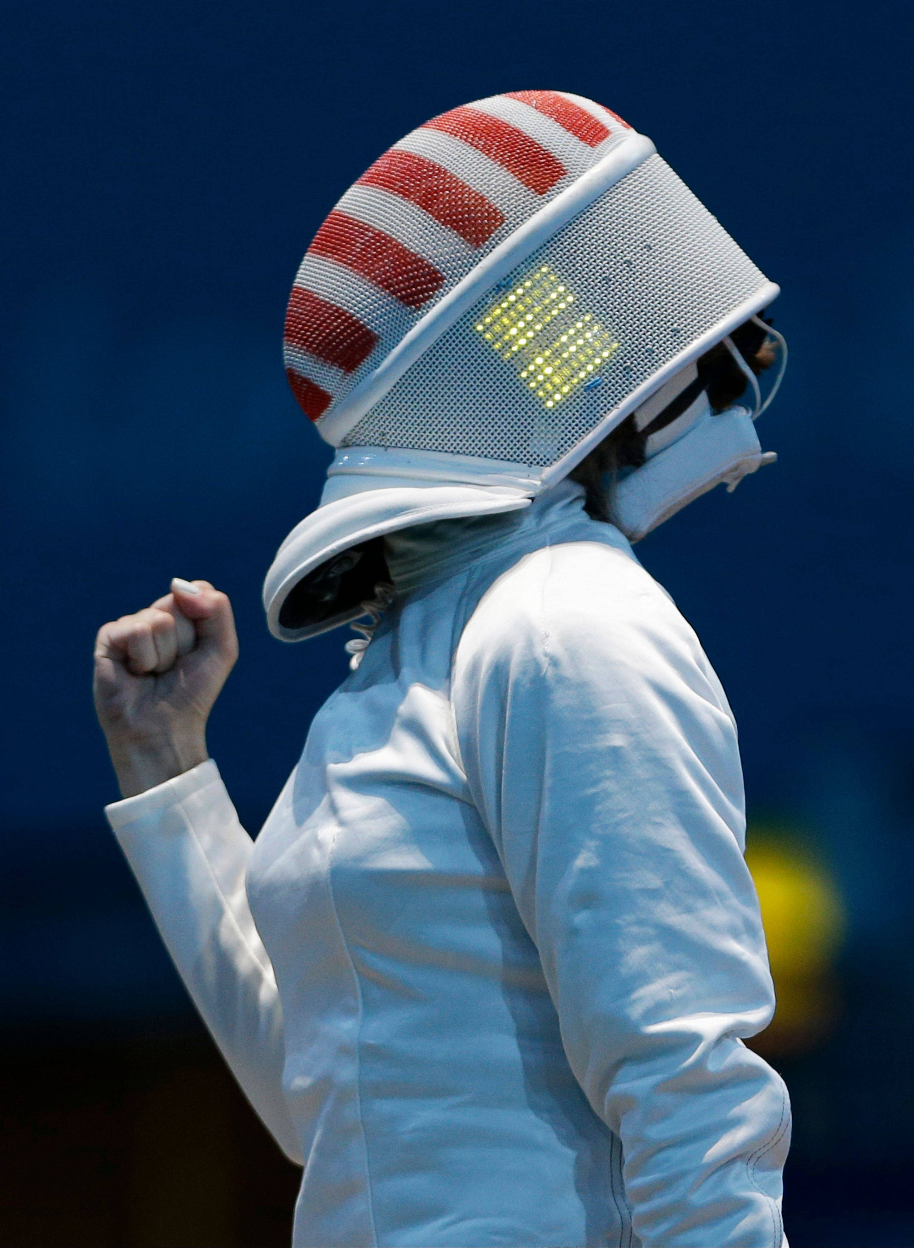 United States' Susie Scanlan reacts during her match against Italy's Nathalie Moellhausen in women's team epee fencing at the 2012 Summer Olympics, Saturday, Aug. 4, 2012, in London.